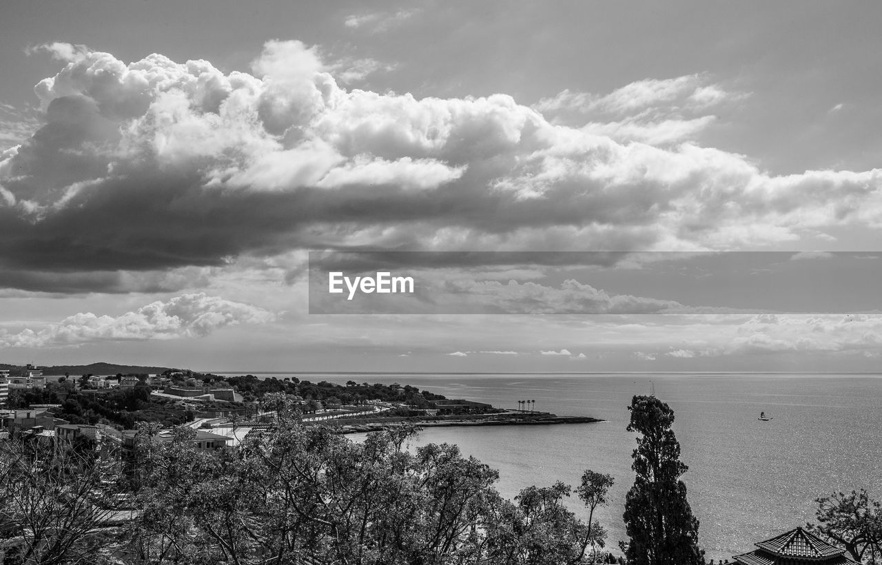 cloud - sky, sky, water, sea, beauty in nature, scenics - nature, nature, tranquil scene, tranquility, day, tree, no people, plant, outdoors, land, horizon, beach, idyllic, high angle view, cityscape