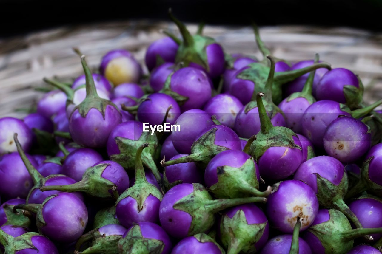 Close-Up Of Eggplants In Basket For Sale