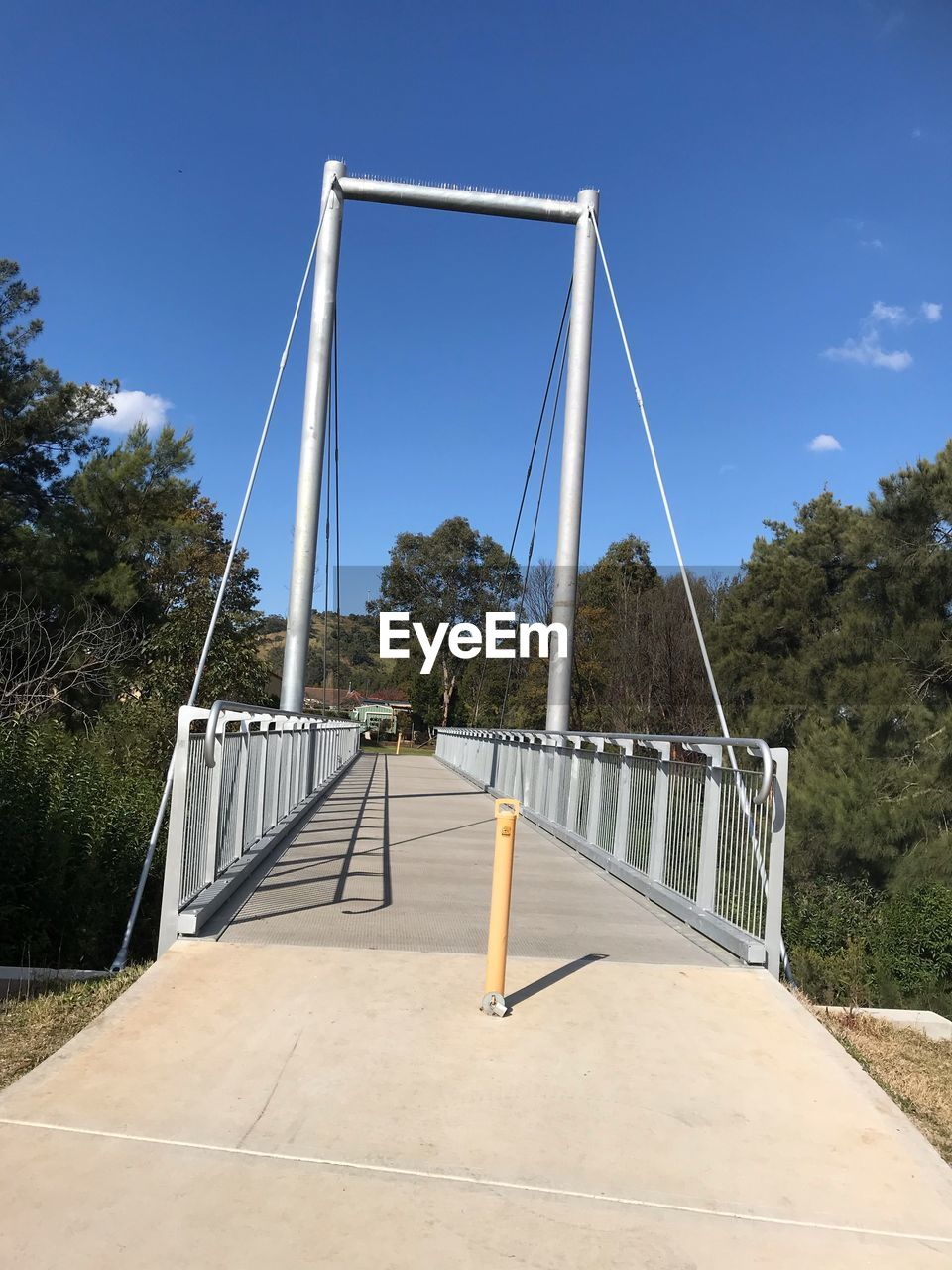 sky, tree, nature, plant, bridge, architecture, connection, day, no people, blue, bridge - man made structure, built structure, sunlight, outdoors, transportation, clear sky, the way forward, playground, metal, direction