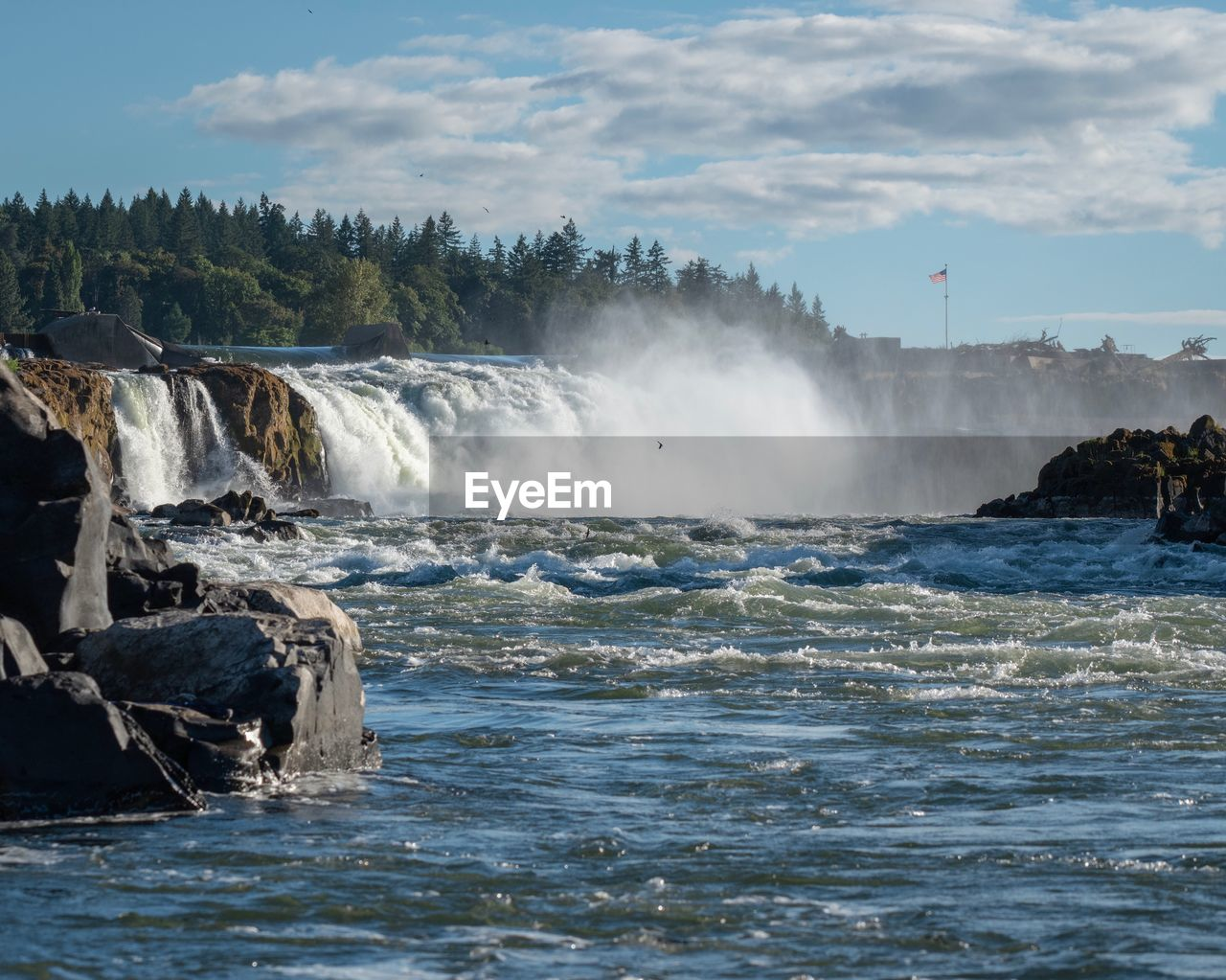 water, motion, scenics - nature, beauty in nature, sky, power, power in nature, sea, flowing water, nature, waterfall, waterfront, long exposure, day, splashing, rock, blurred motion, tree, travel destinations, flowing, outdoors, no people, spraying
