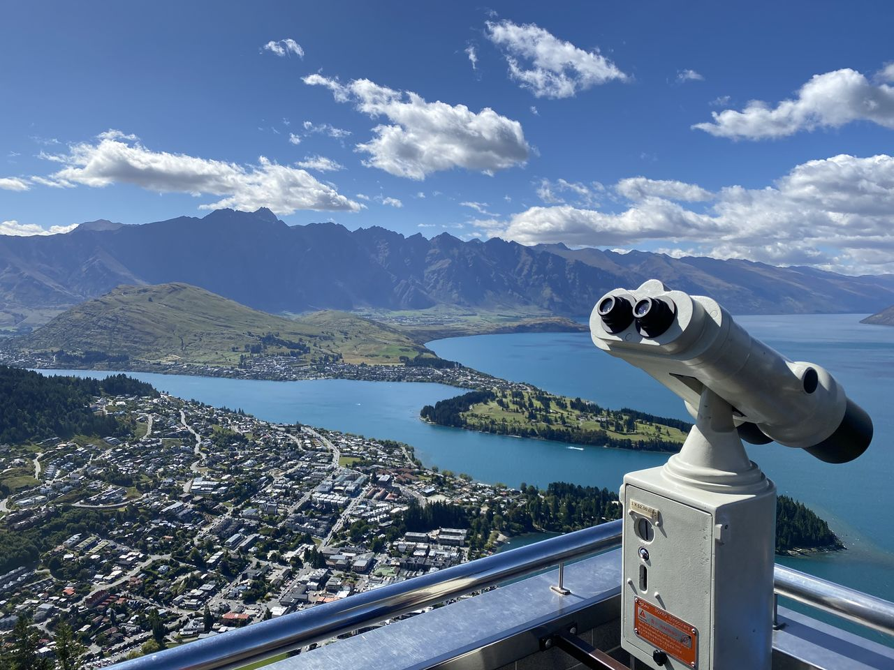 water, binoculars, coin operated, mountain, sky, coin-operated binoculars, beauty in nature, nature, sea, cloud - sky, scenics - nature, day, no people, optical instrument, observation point, telescope, sunlight, tranquil scene, mountain range, astronomy, outdoors, hand-held telescope