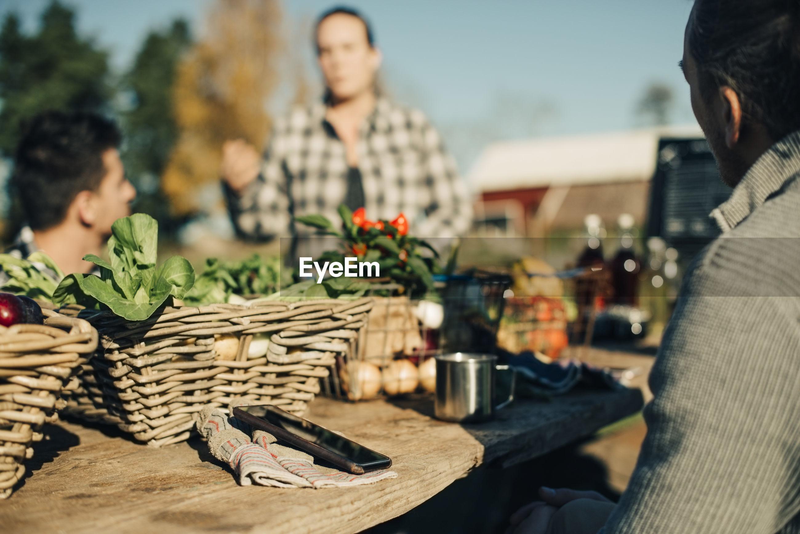 PEOPLE SITTING ON TABLE AT SIDEWALK