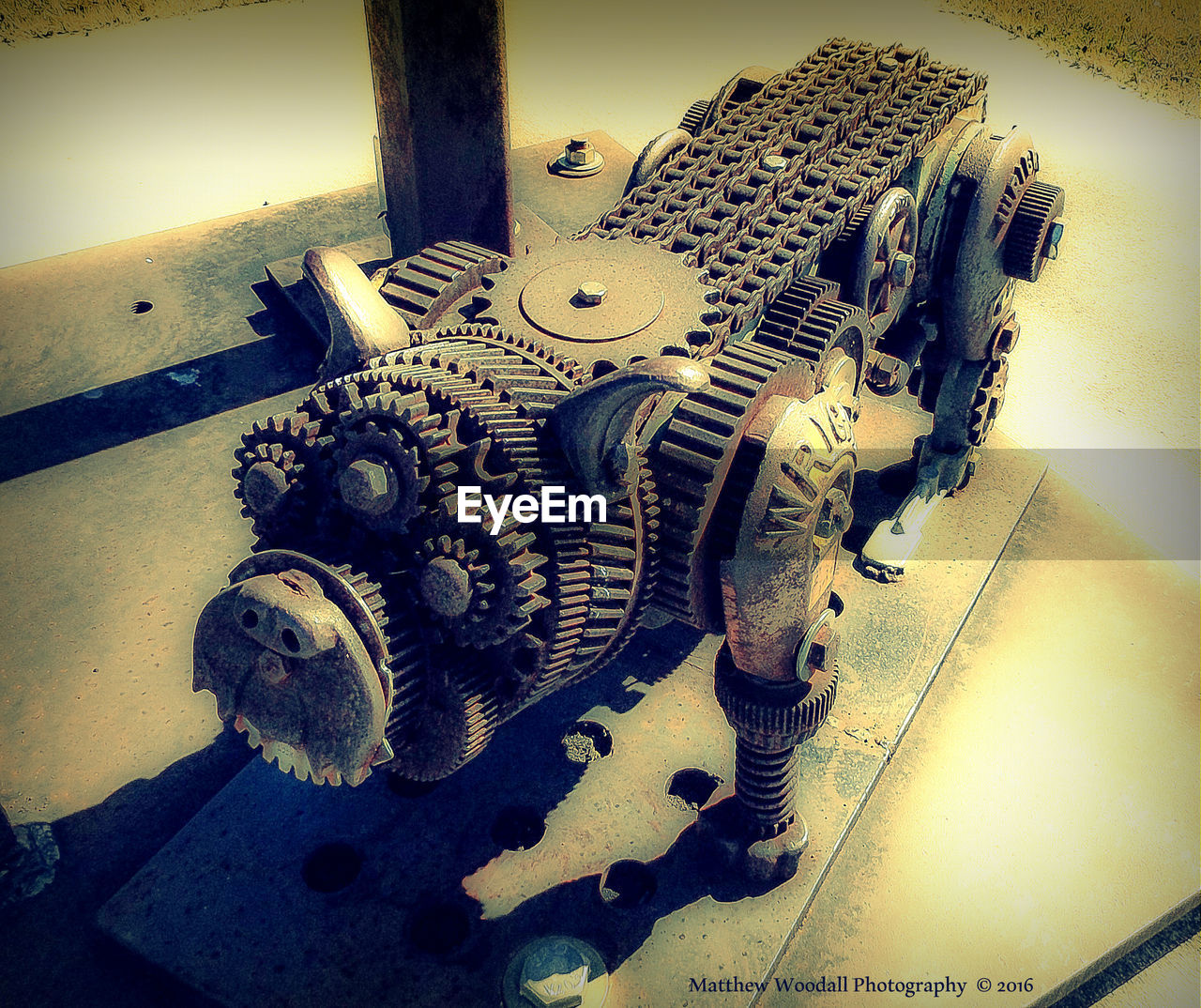 high angle view, machine part, no people, indoors, machinery, workshop, fish-eye lens, manufacturing equipment, technology, gear, day, close-up