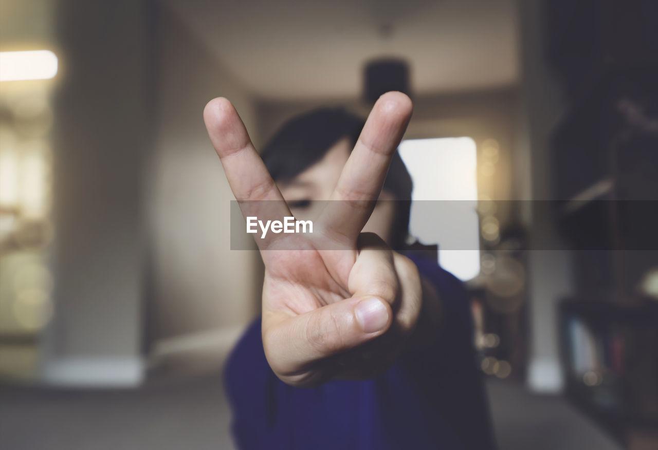 Close-up of boy gesturing