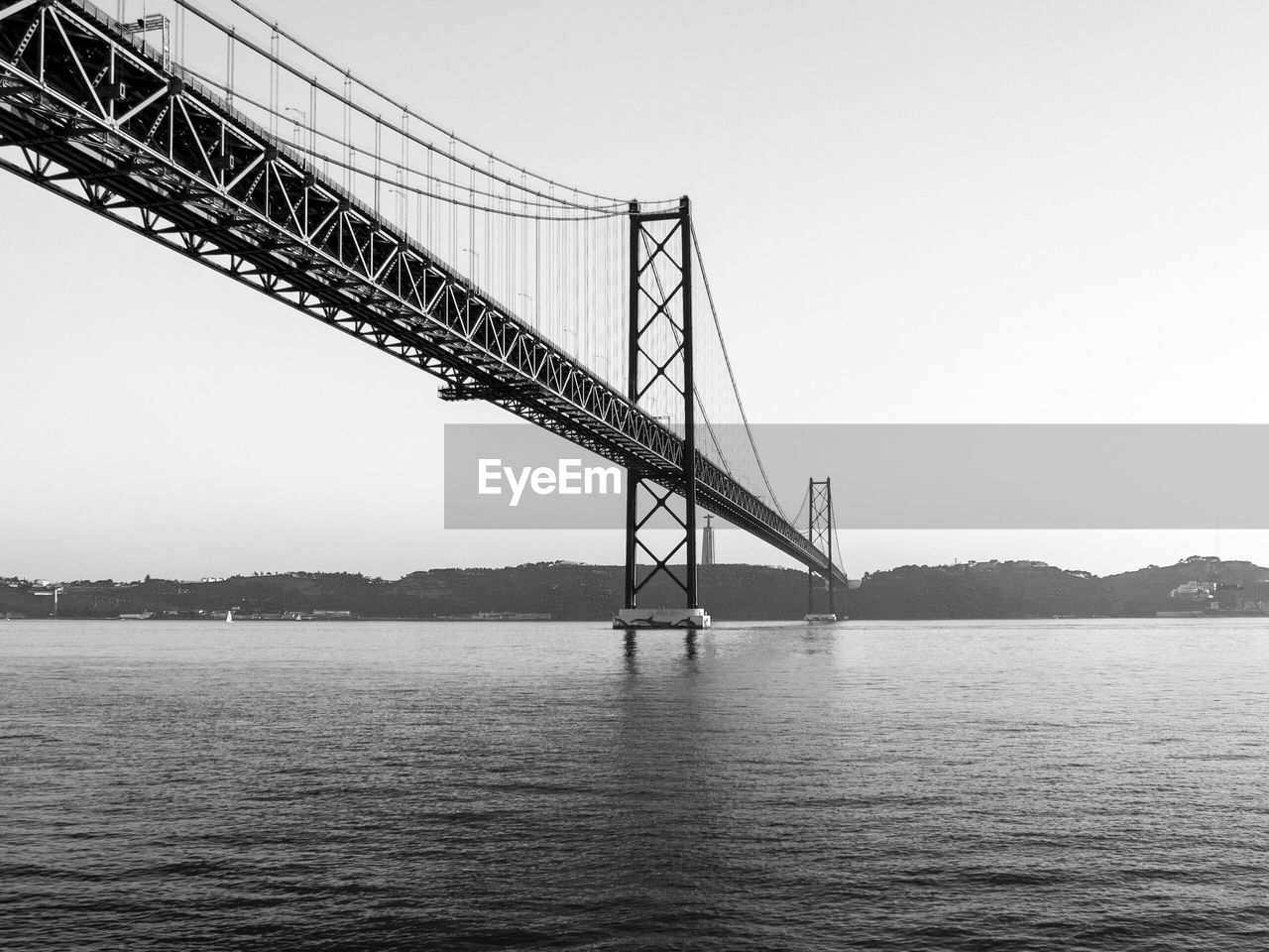 connection, bridge - man made structure, engineering, transportation, suspension bridge, architecture, built structure, no people, travel, river, water, outdoors, travel destinations, bridge, waterfront, sky, day, low angle view, nature, tranquility, clear sky, city