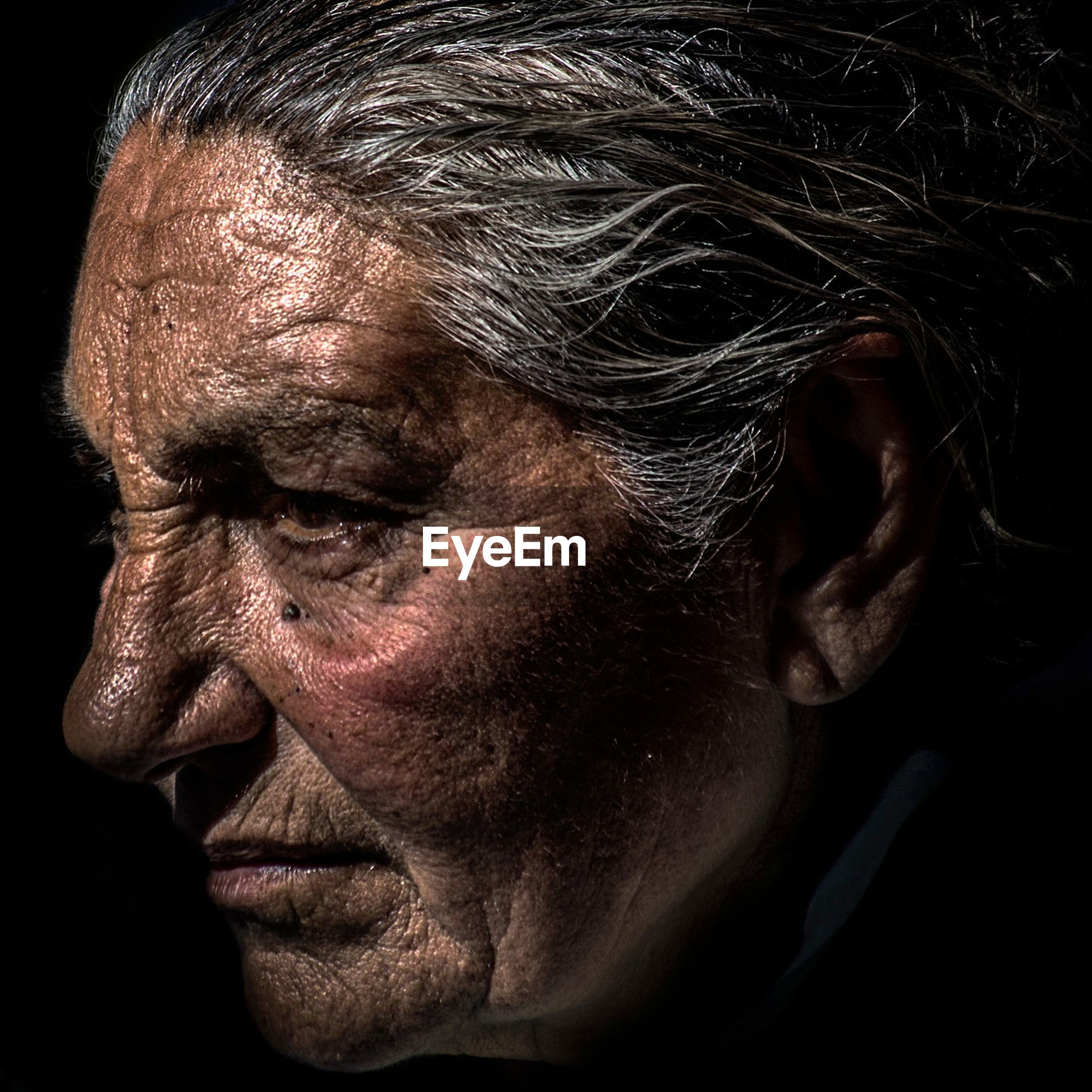 adults only, only men, one man only, black background, close-up, studio shot, human face, one person, adult, human body part, depression - sadness, portrait, people