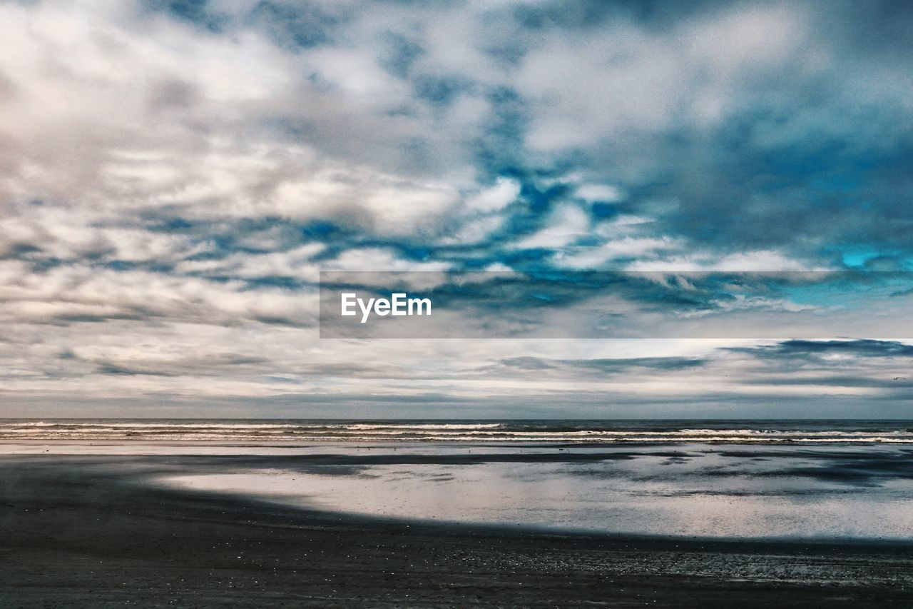 cloud - sky, sky, water, sea, scenics - nature, beauty in nature, land, tranquility, beach, tranquil scene, horizon over water, horizon, nature, no people, outdoors, idyllic, non-urban scene, day, sand