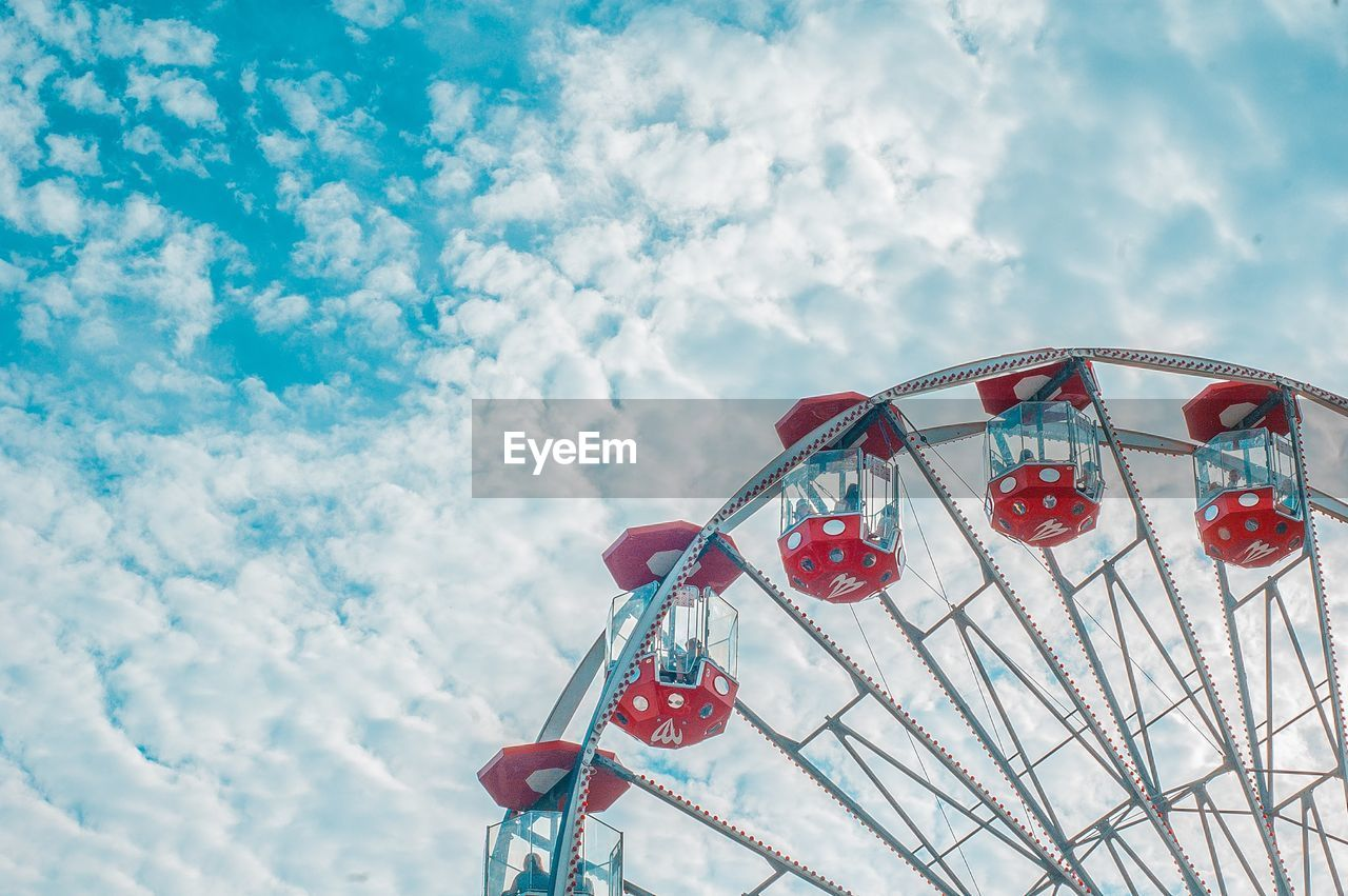 cloud - sky, sky, low angle view, outdoors, day, no people, ferris wheel, amusement park, arts culture and entertainment, red, hanging, nature, multi colored