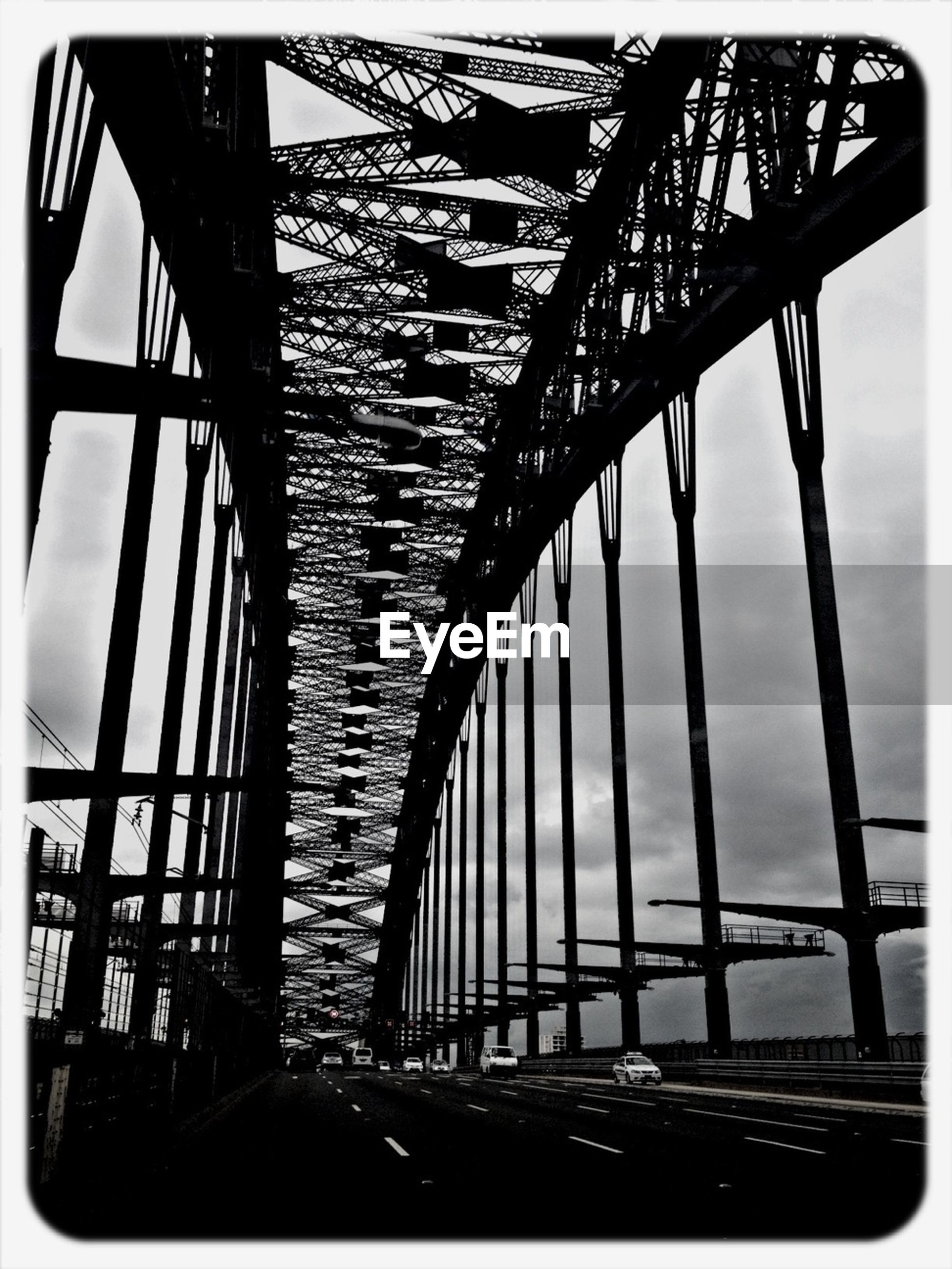 bridge - man made structure, connection, engineering, transfer print, built structure, architecture, bridge, transportation, low angle view, auto post production filter, metal, sky, diminishing perspective, railing, long, suspension bridge, the way forward, metallic, no people, outdoors