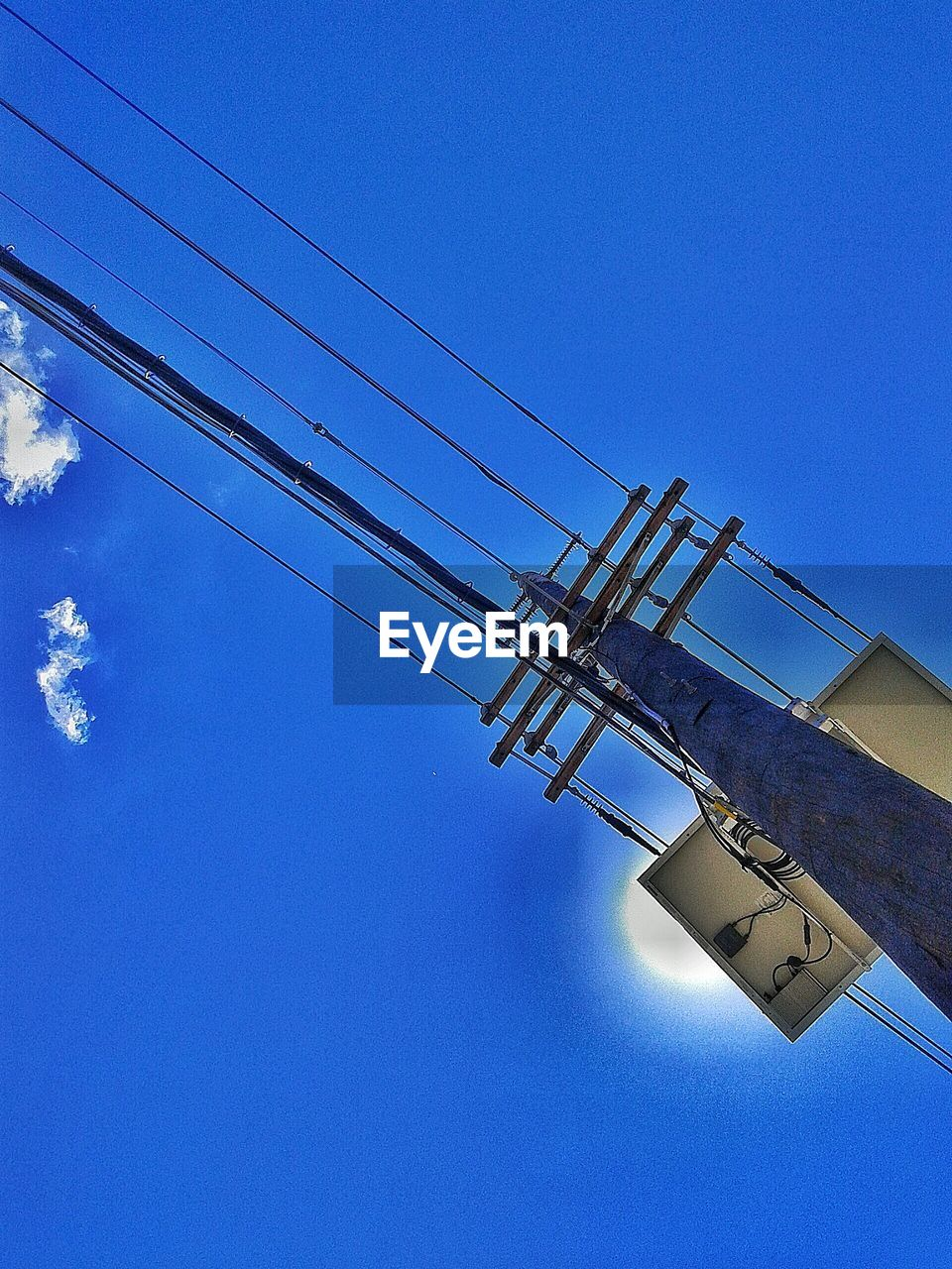 blue, low angle view, cable, clear sky, connection, no people, day, outdoors, electricity, technology, electricity pylon, sky