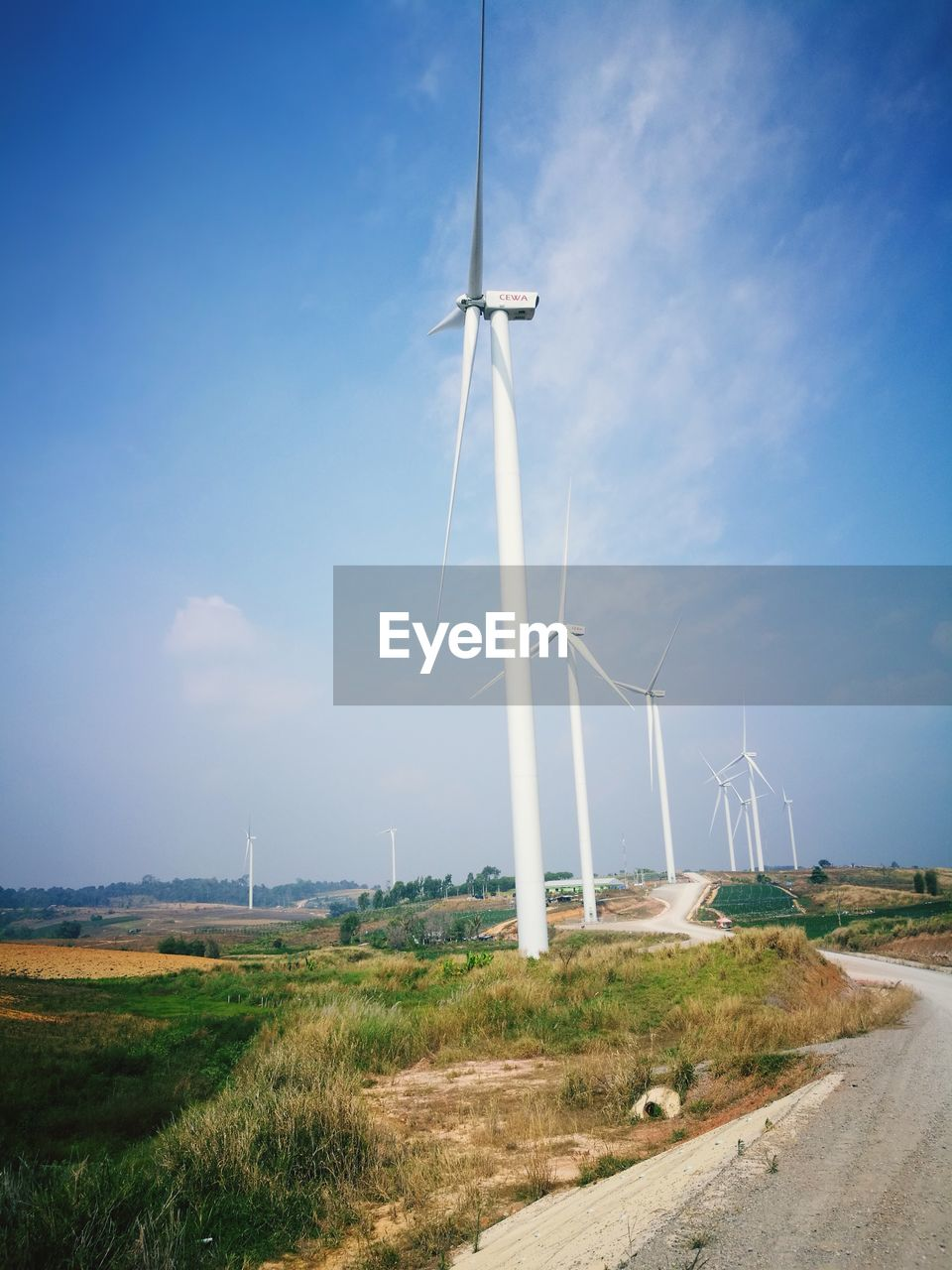 fuel and power generation, turbine, wind turbine, environment, wind power, renewable energy, alternative energy, sky, environmental conservation, landscape, field, nature, land, road, rural scene, day, no people, technology, grass, cloud - sky, outdoors, power supply, sustainable resources