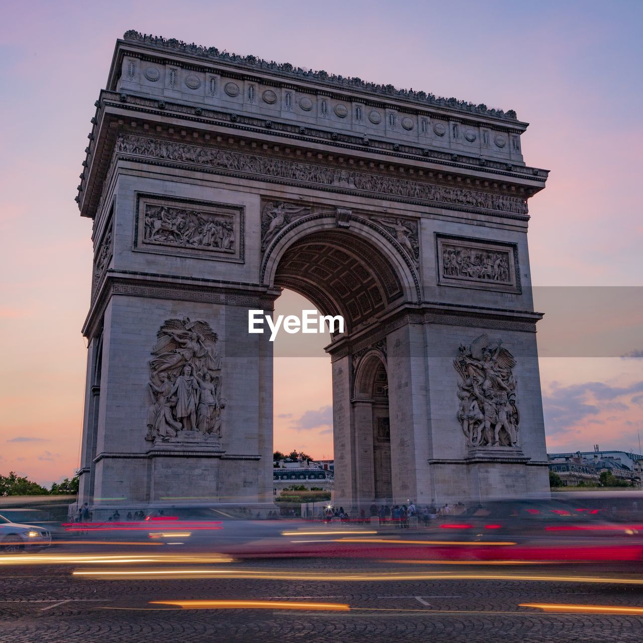 architecture, triumphal arch, arch, built structure, sky, monument, travel destinations, history, the past, city, sunset, art and craft, transportation, motion, nature, road, sculpture, street, tourism, low angle view, no people, outdoors