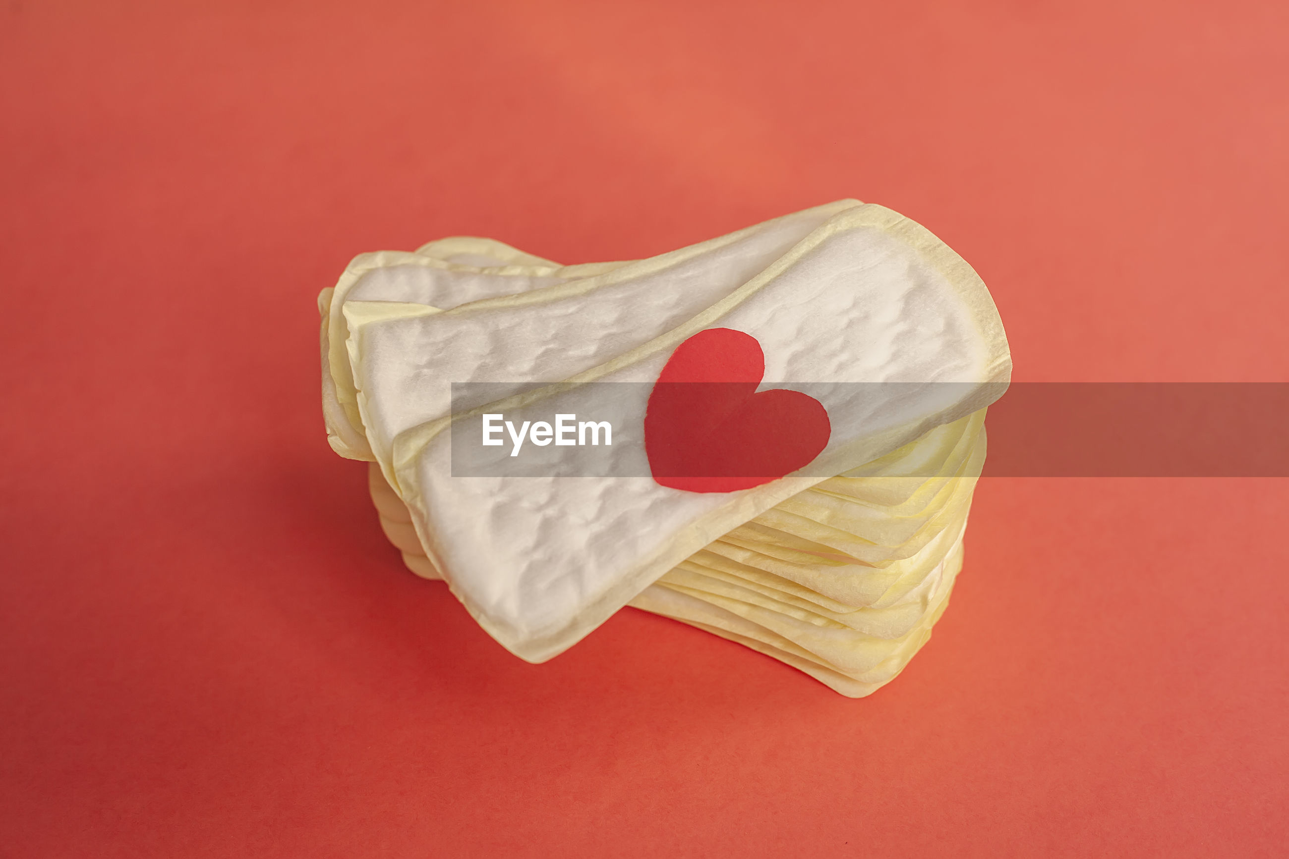 Close-up of sanitary pads against red background
