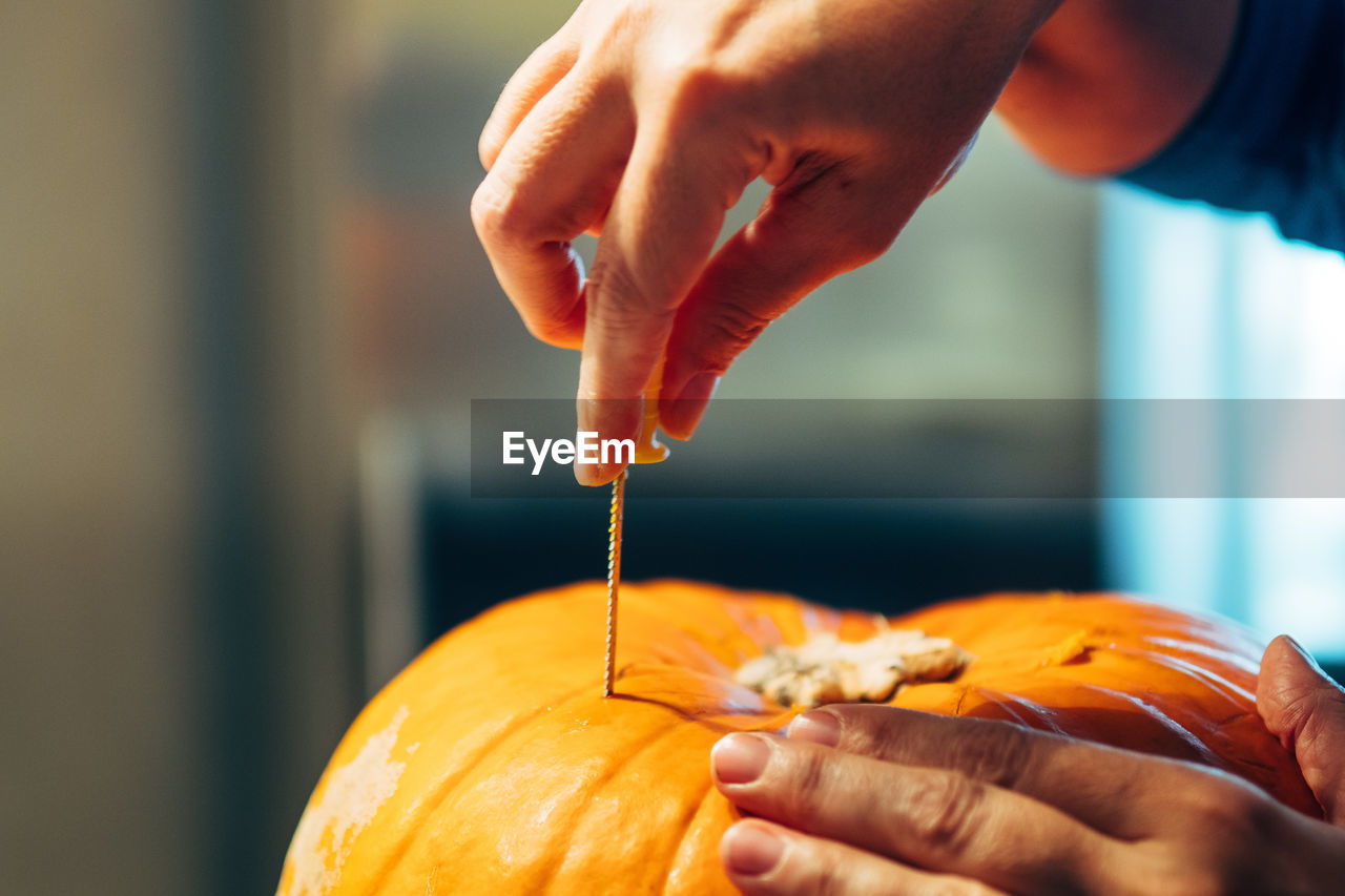 Cropped Hand Of Person Making Jack O Lantern
