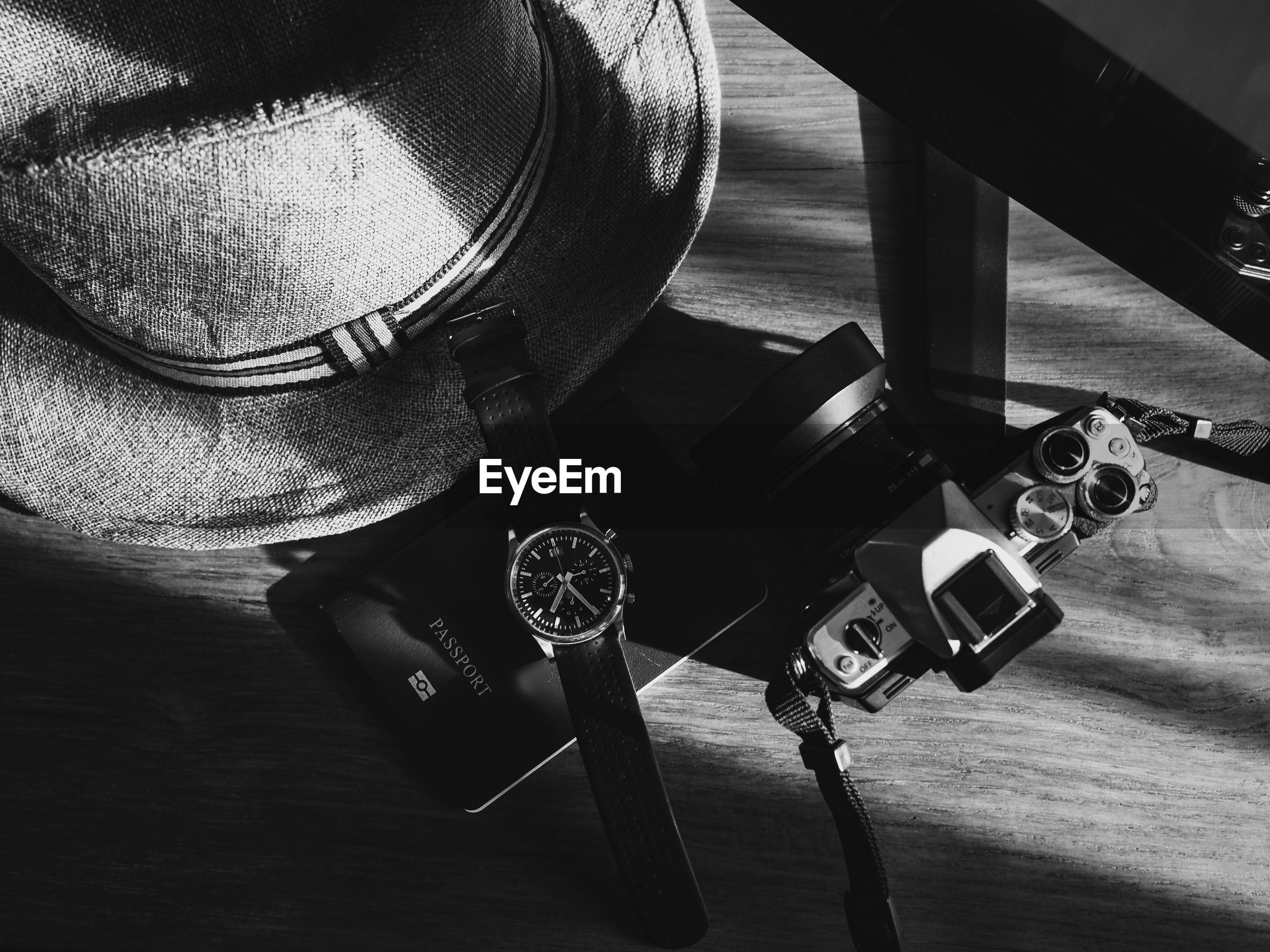 HIGH ANGLE VIEW OF CAMERA ON TABLE AT NIGHTCLUB