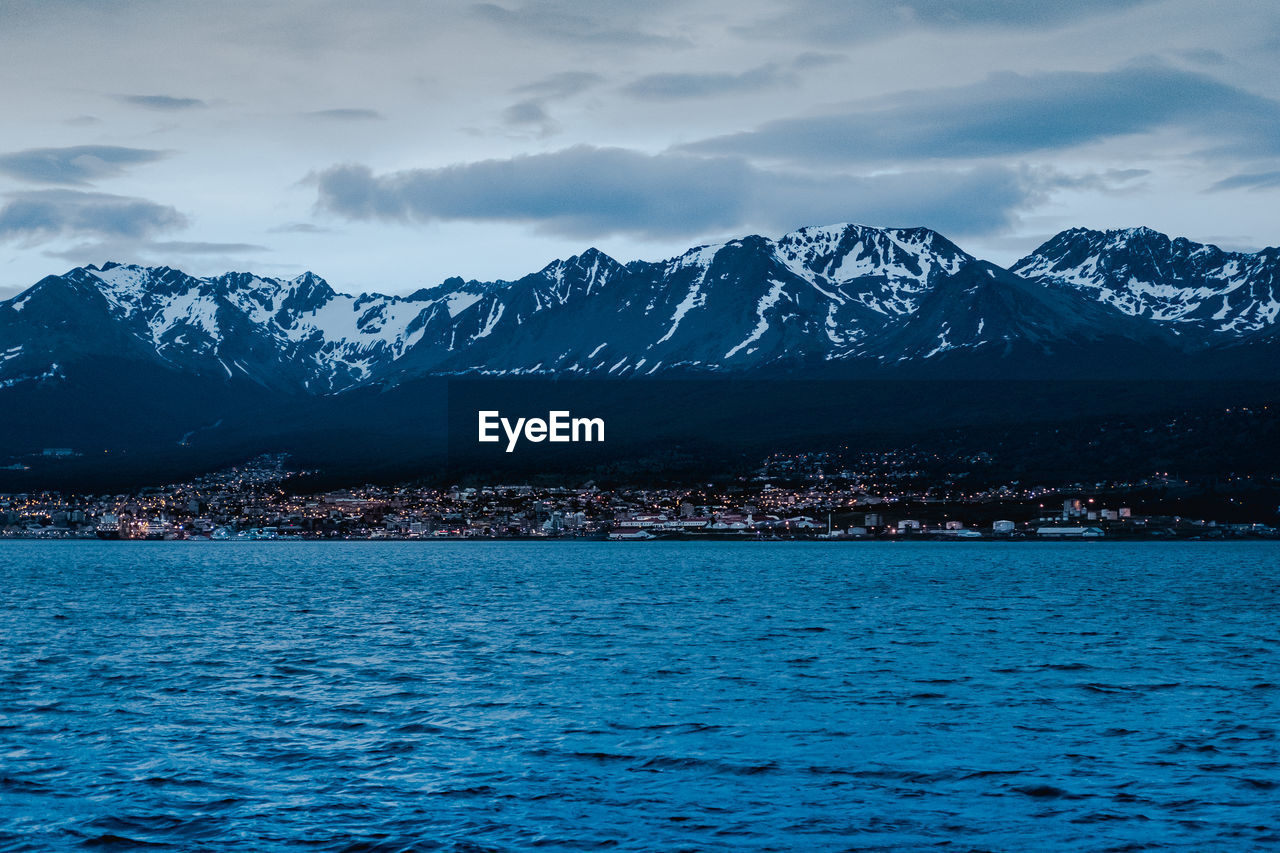 mountain, winter, scenics - nature, sky, cold temperature, beauty in nature, mountain range, snow, water, cloud - sky, architecture, snowcapped mountain, waterfront, nature, no people, tranquil scene, tranquility, building exterior, outdoors