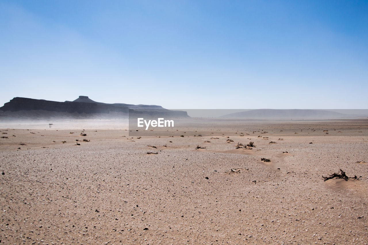 scenics - nature, environment, tranquil scene, beauty in nature, sky, landscape, tranquility, land, non-urban scene, mountain, desert, nature, remote, copy space, day, blue, climate, no people, arid climate, barren, outdoors, salt flat