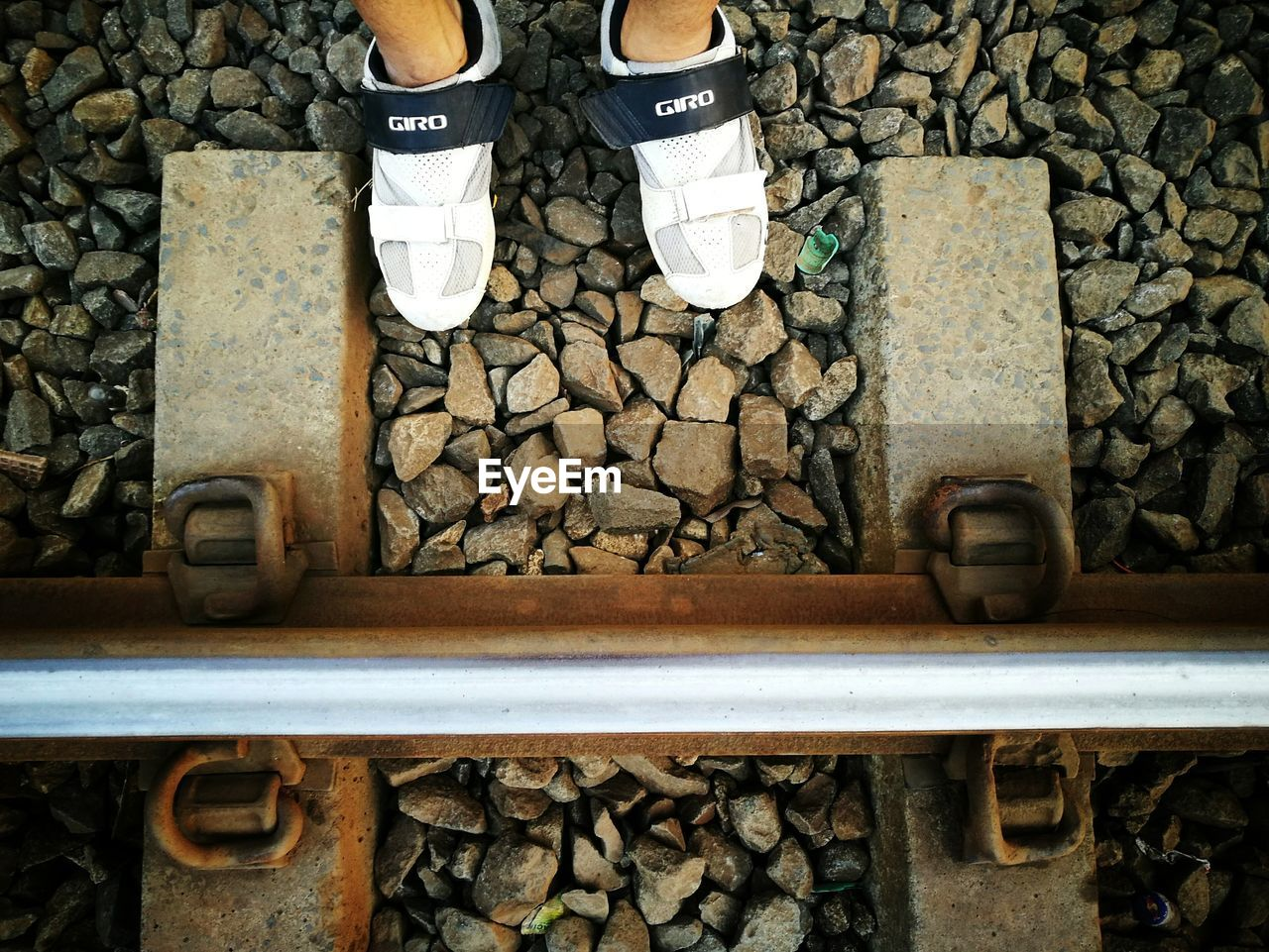 shoe, human leg, standing, low section, one person, human body part, outdoors, day, pebble, railroad track, real people, men, close-up, people