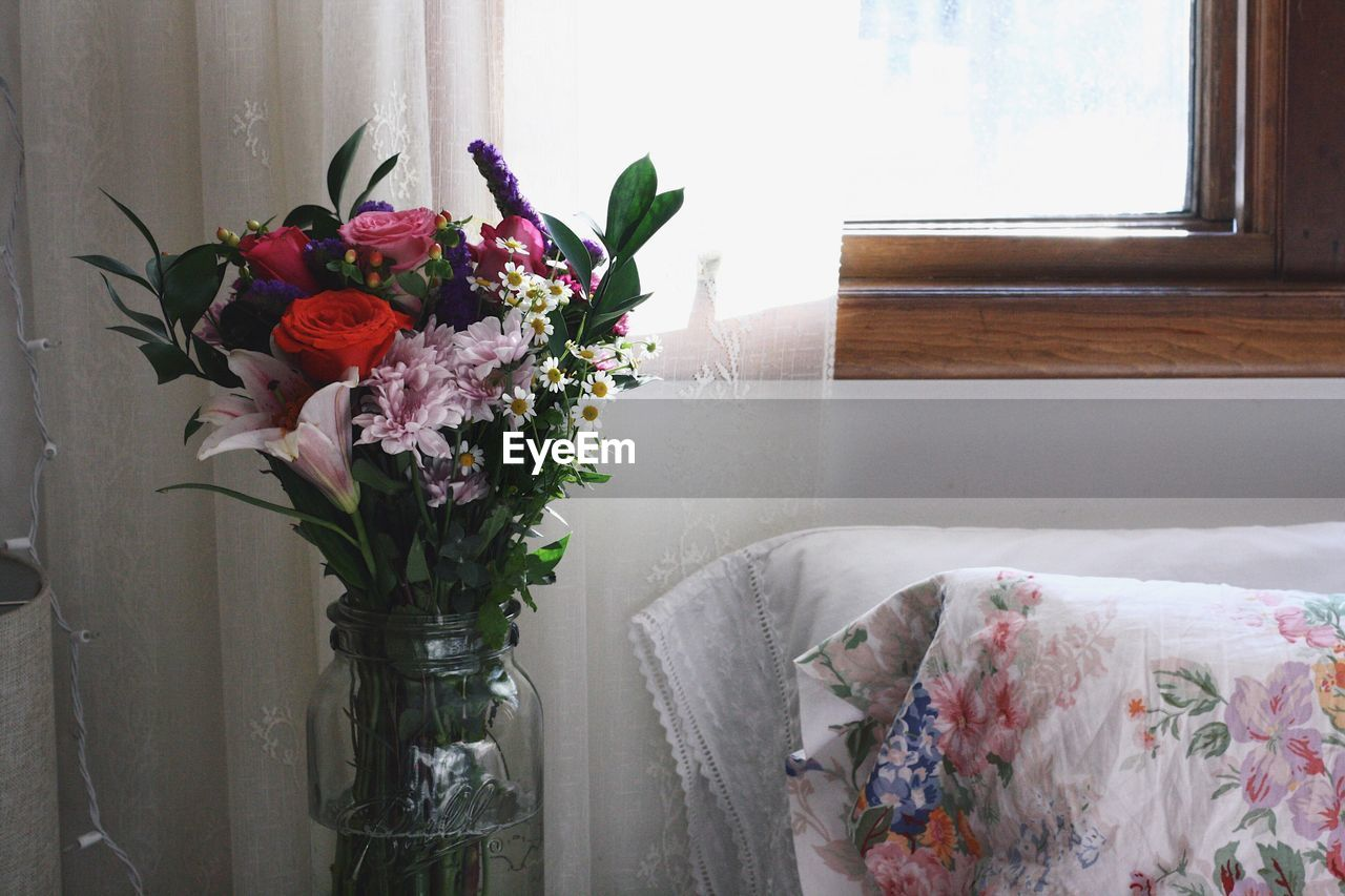 flower, vase, bouquet, curtain, rose - flower, indoors, flower arrangement, table, no people, window, bed, home interior, day, fragility, bedroom, freshness, close-up, flower head