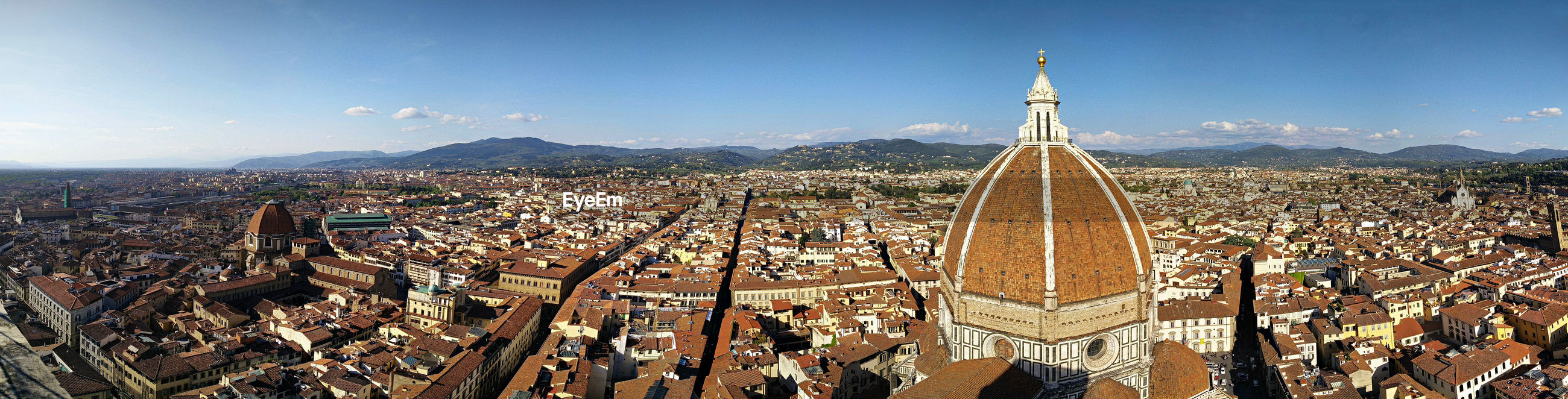 Panoramic view of duomo santa maria del fiore with cityscape against sky