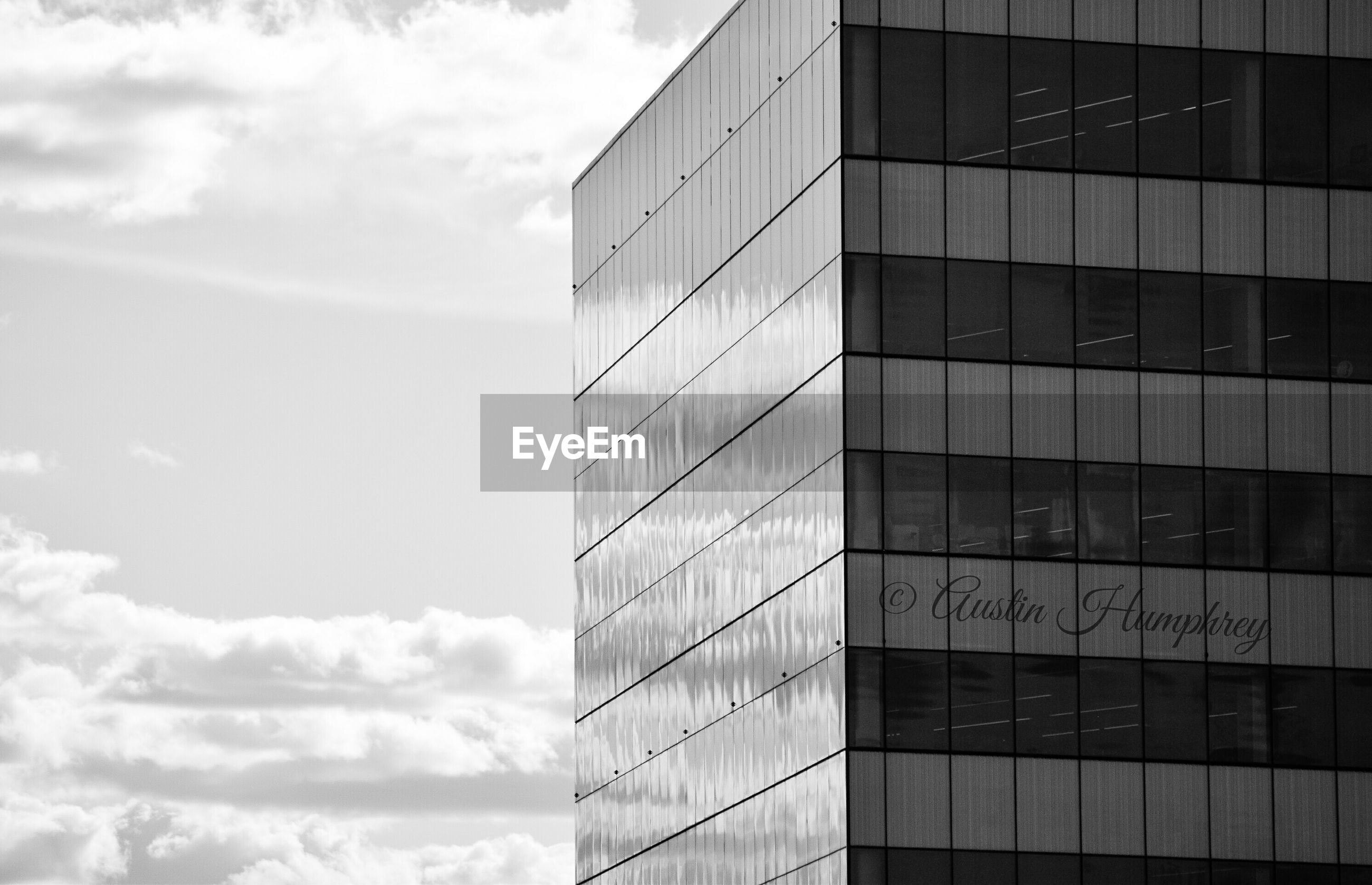 architecture, building exterior, built structure, modern, office building, sky, low angle view, city, glass - material, reflection, cloud - sky, skyscraper, building, window, tower, tall - high, day, cloud, pattern, outdoors