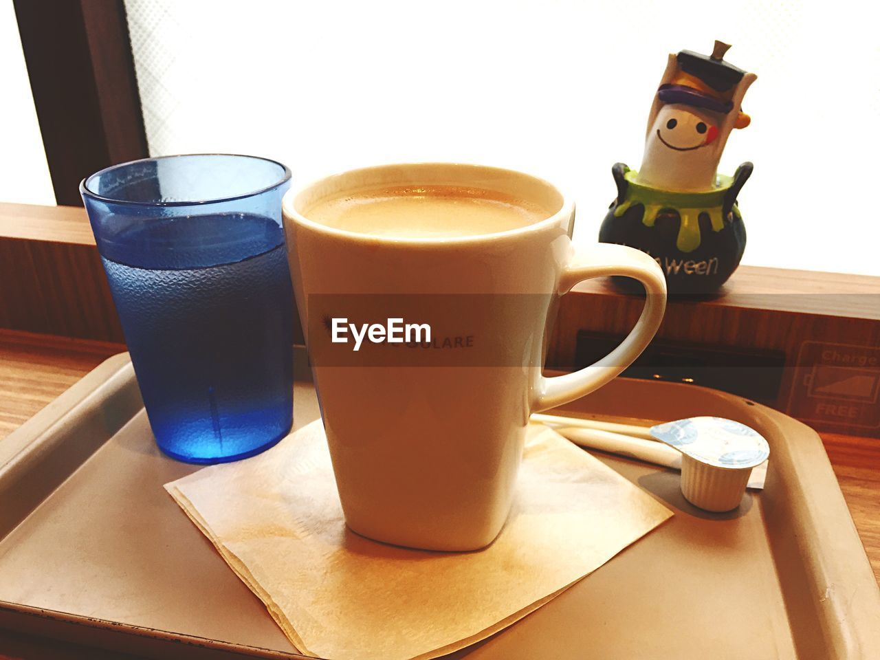CLOSE-UP OF COFFEE CUP AND TABLE