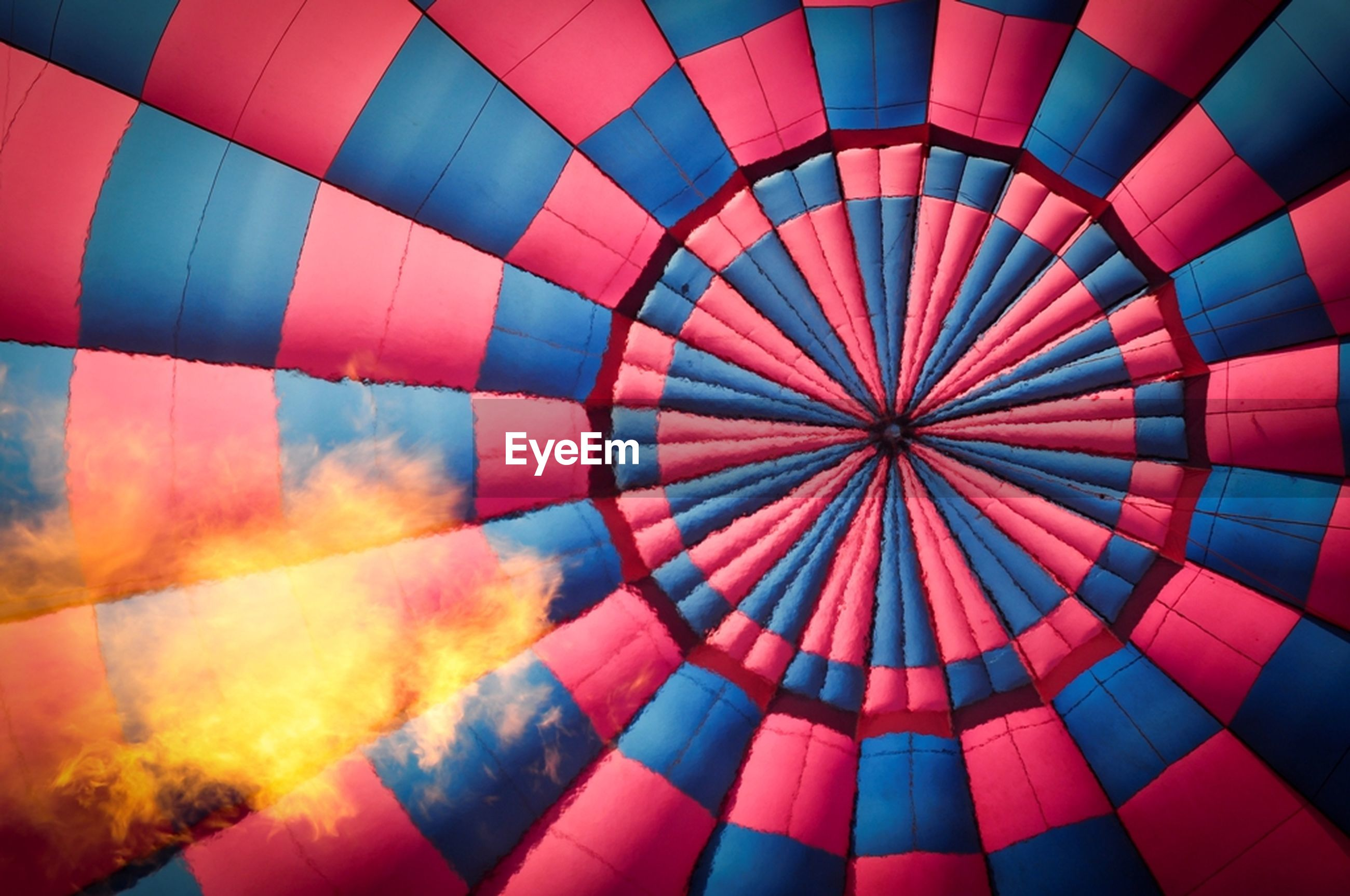 multi colored, flying, hot air balloon, full frame, outdoors, no people, low angle view, sky, air vehicle, day, close-up, ballooning festival