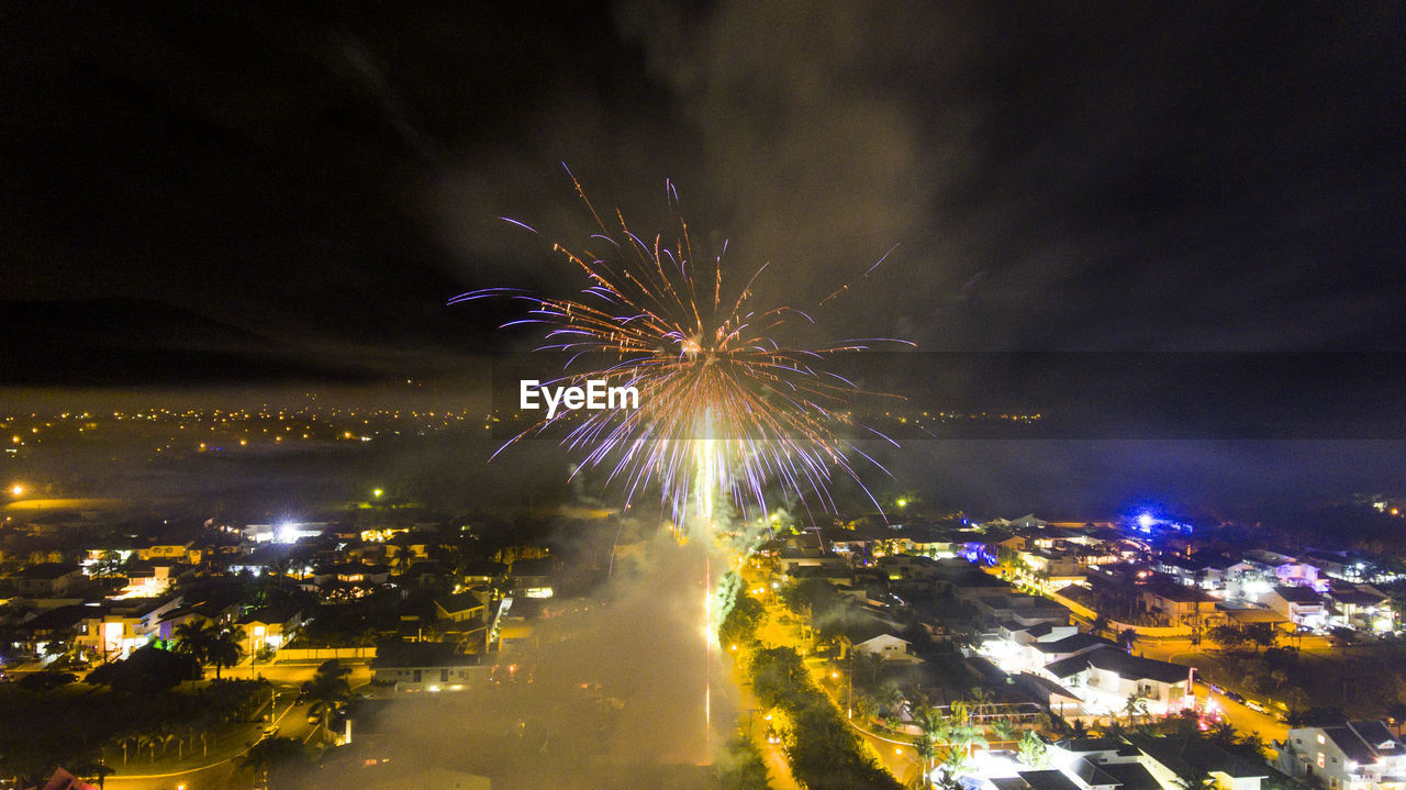 illuminated, night, building exterior, architecture, firework, city, built structure, motion, cityscape, no people, arts culture and entertainment, sky, glowing, firework display, exploding, celebration, long exposure, event, nature, building, light, outdoors, firework - man made object