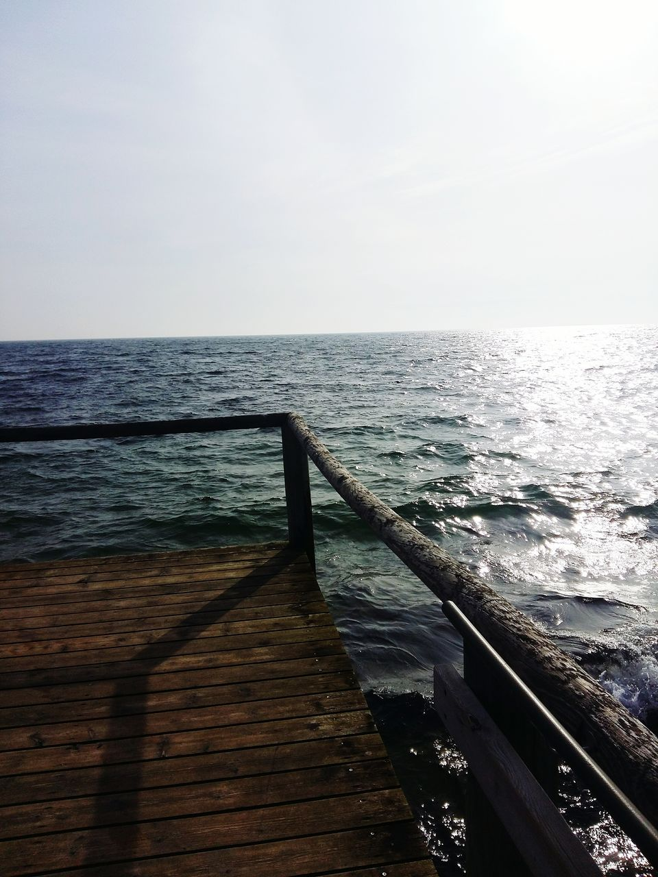 sea, water, horizon over water, nature, scenics, beauty in nature, wood - material, no people, tranquility, tranquil scene, sky, clear sky, outdoors, day