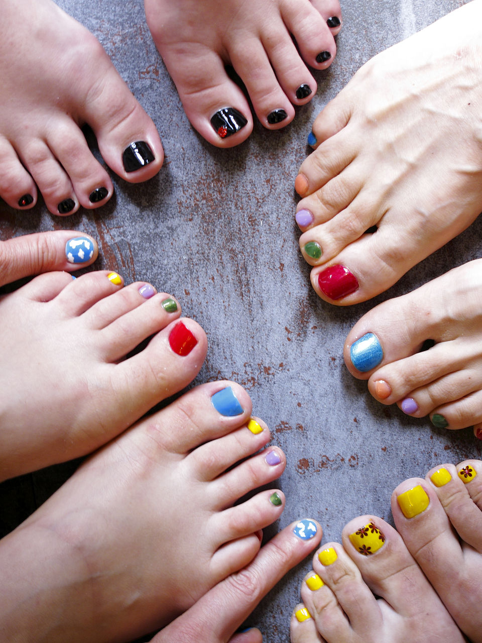 Low Section Of Females With Colorful Nail Polishes