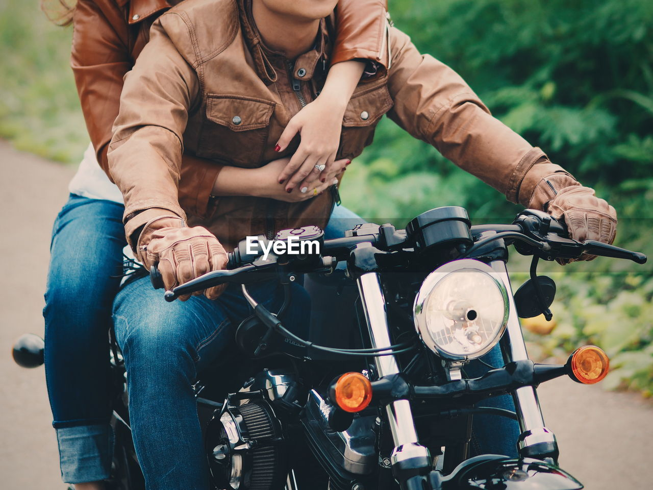 Midsection Of Couple On Motorcycle