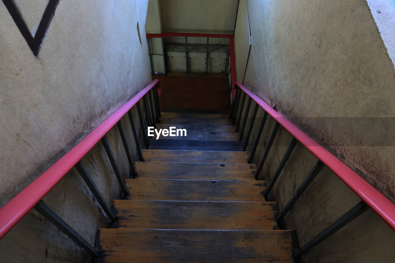 architecture, staircase, railing, steps and staircases, indoors, built structure, no people, the way forward, direction, high angle view, empty, day, wall - building feature, absence, metal, building, wood - material, diminishing perspective, wall