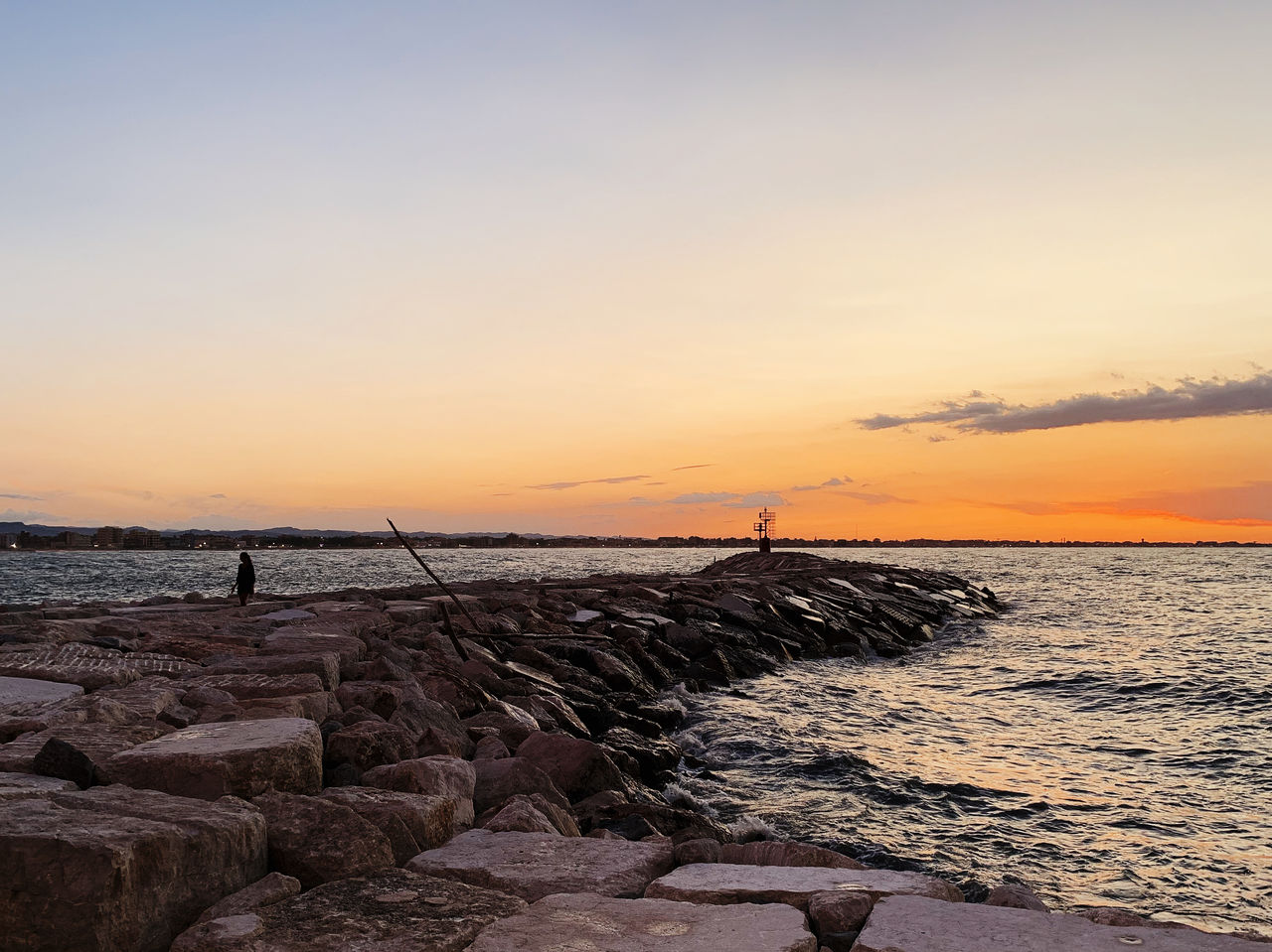 sky, sunset, sea, water, beauty in nature, scenics - nature, rock, rock - object, solid, beach, tranquility, tranquil scene, horizon over water, land, orange color, horizon, cloud - sky, nature, idyllic, outdoors, groyne