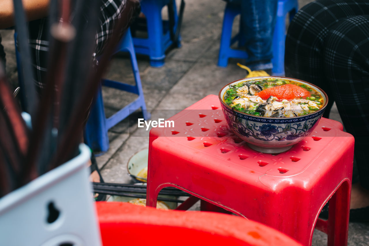 Close-Up Of Seafood In Container On Red Table