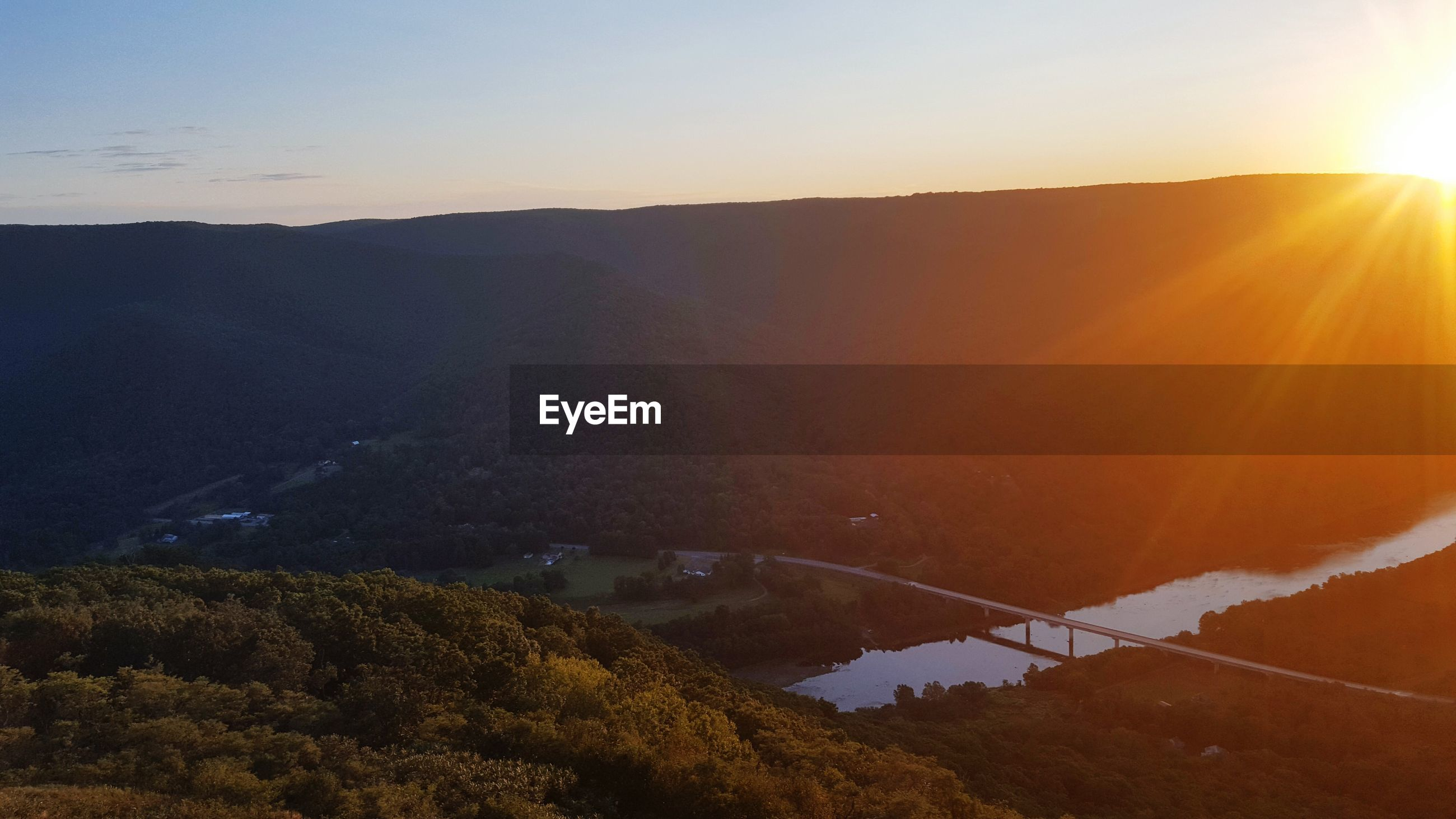 HIGH ANGLE VIEW OF SUNSET OVER MOUNTAIN