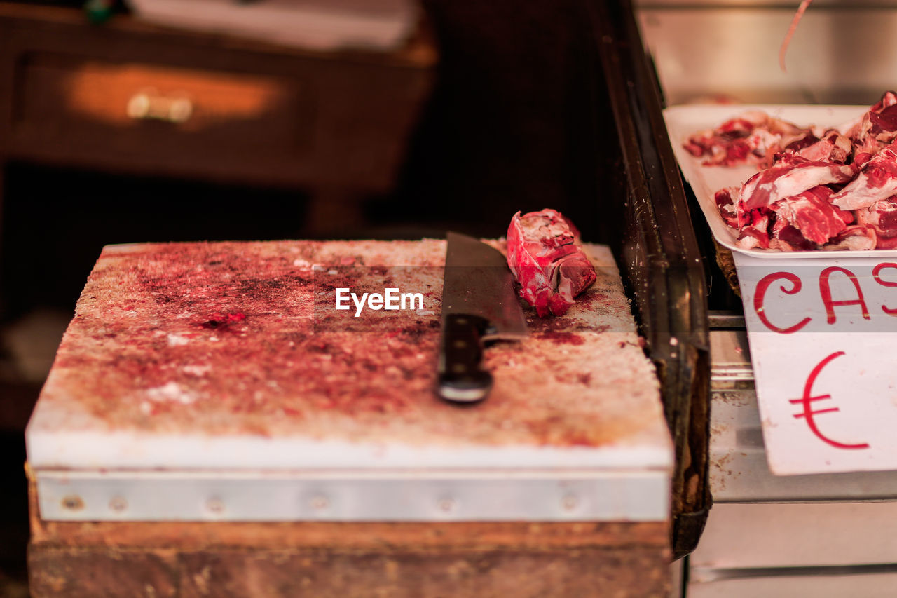 High Angle View Of Knife And Meats On Table In Market