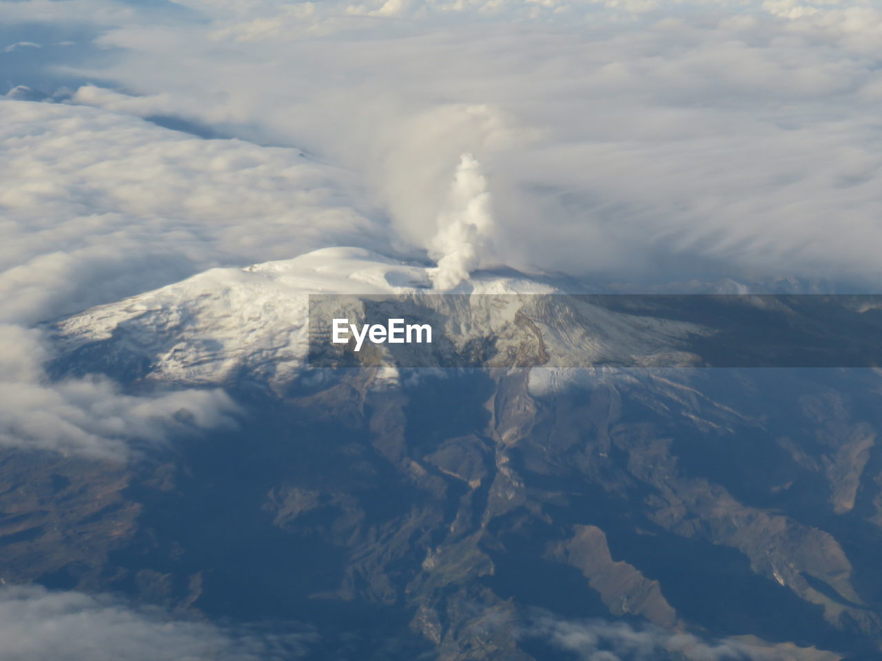 Aerial View Of Clouds Over Mountains Against Sky