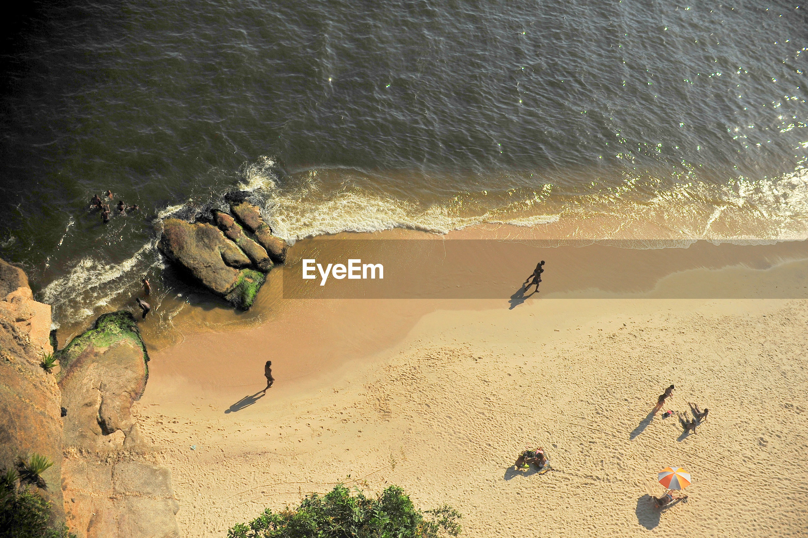 High angle view of people walking on beach