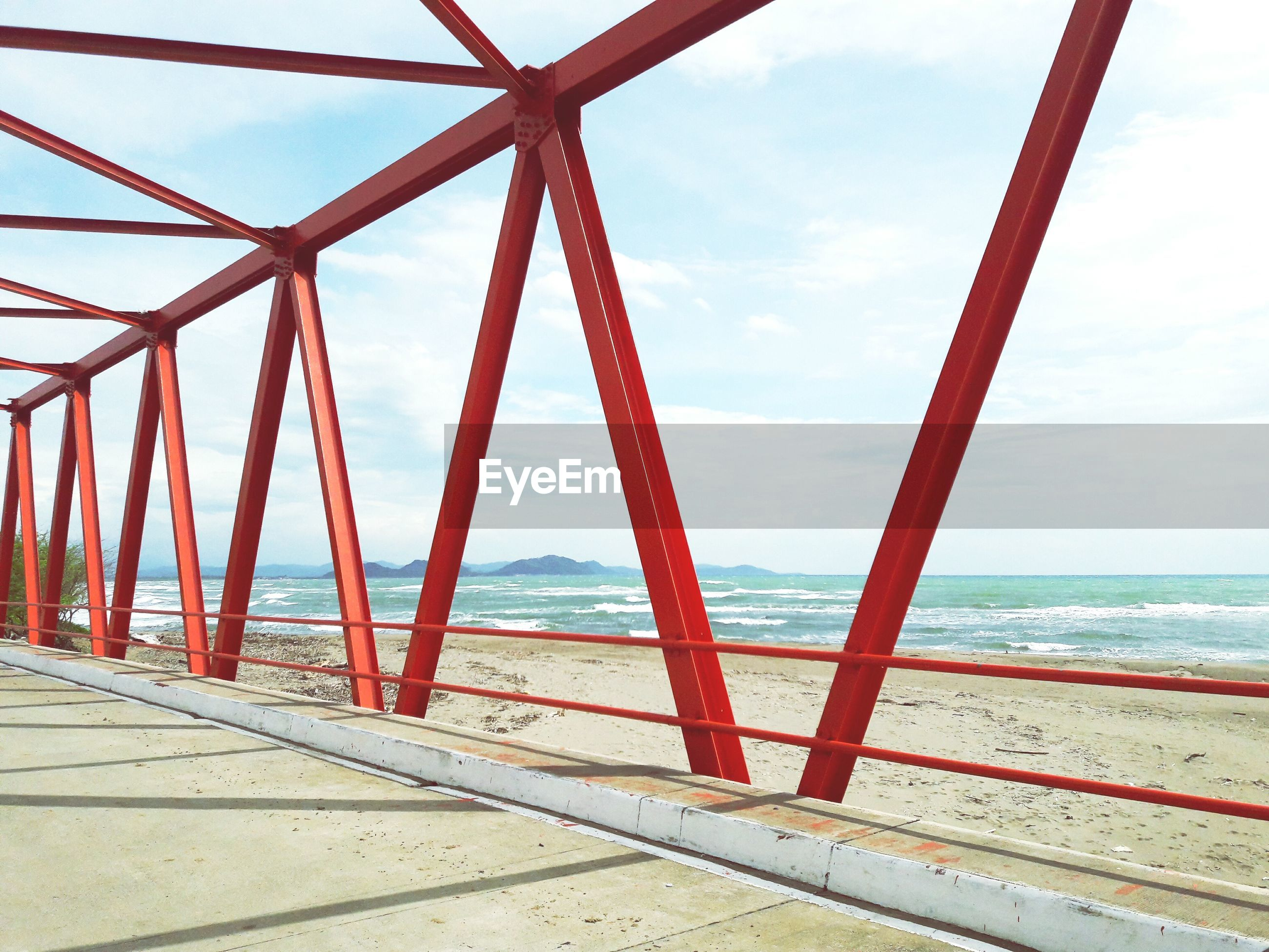 RED BEACH AGAINST SKY