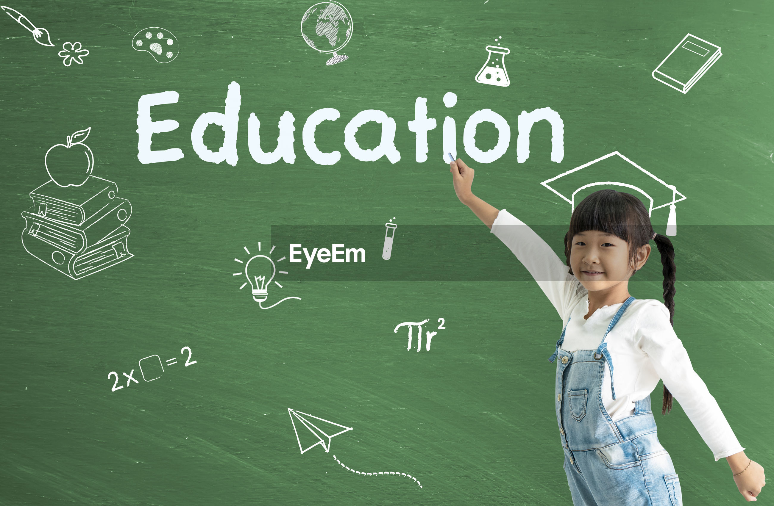 Digital composite image of girl pointing at education text on blackboard