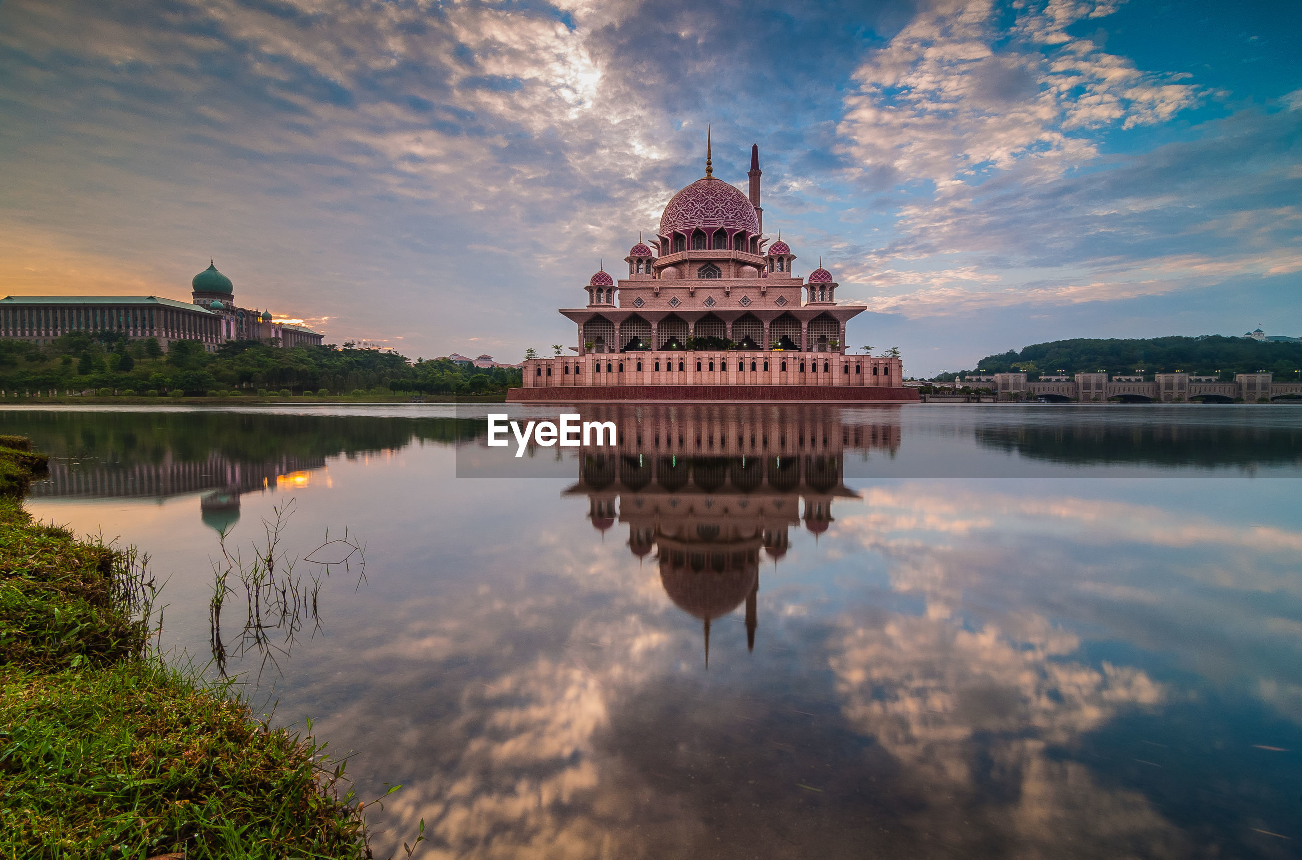 Putra mosque with reflection in lake against sky