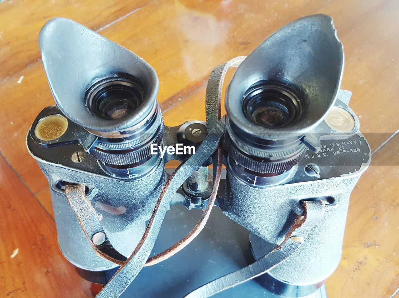 Close-up of binoculars on table