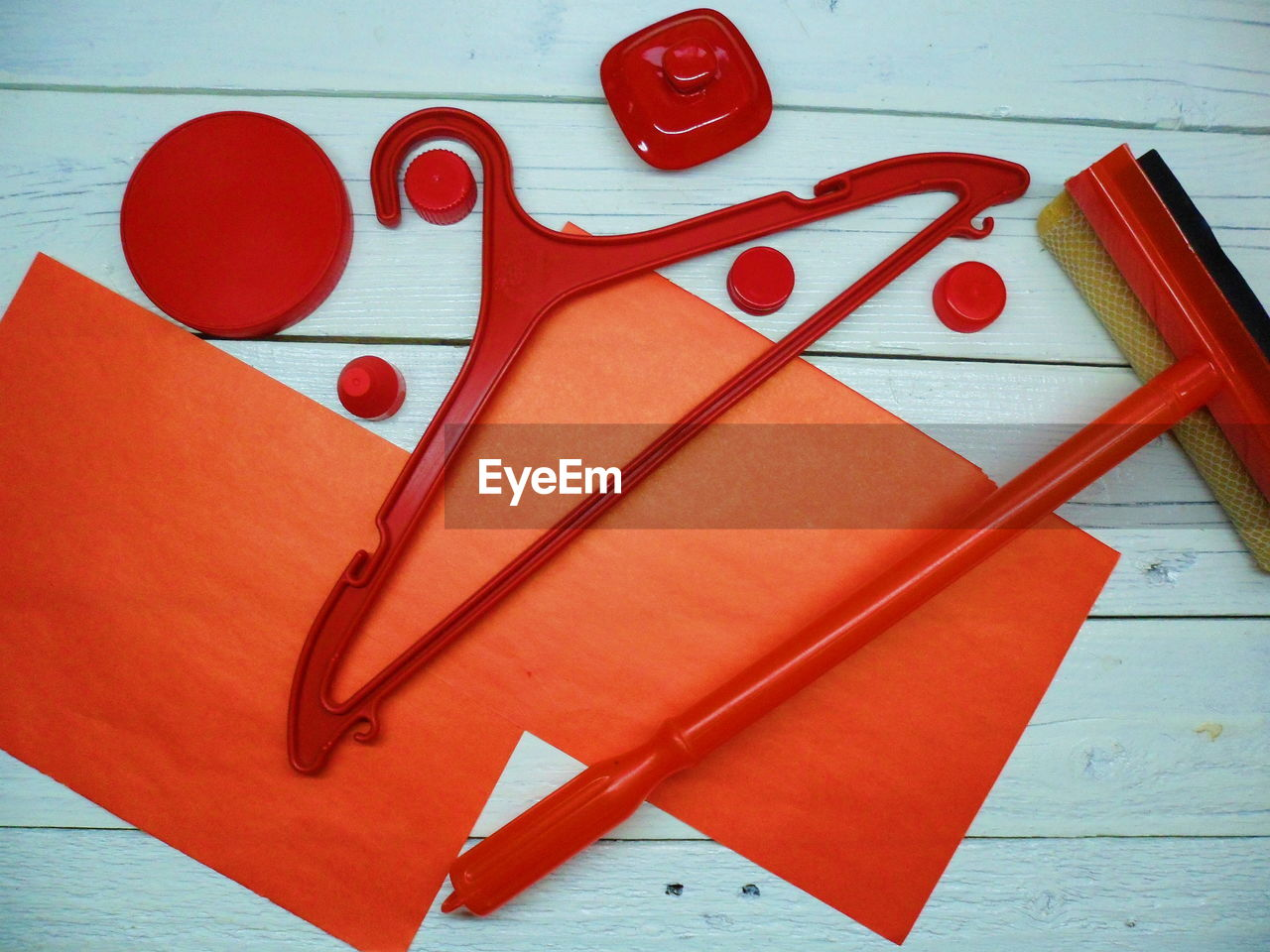 red, still life, indoors, paper, table, close-up, no people, creativity, art and craft, heart shape, high angle view, positive emotion, love, text, wood - material, scissors, education, ruler, communication, group of objects