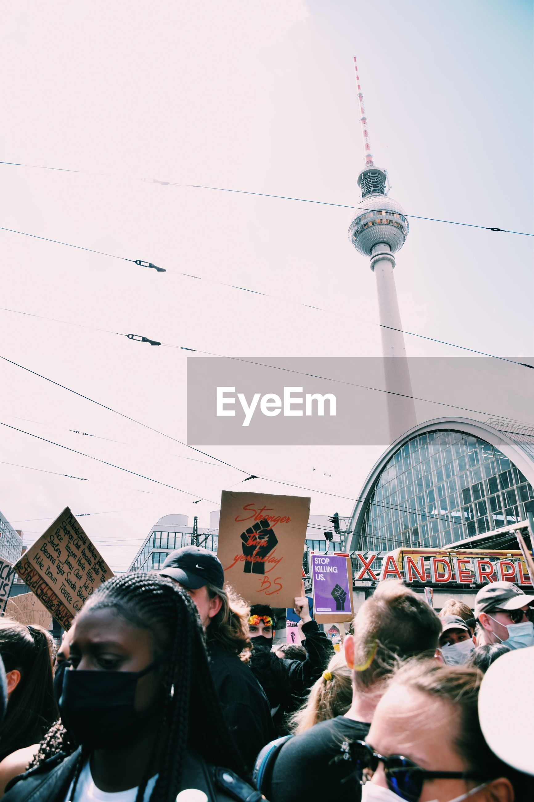 crowd, architecture, group of people, city, built structure, building exterior, sky, adult, men, technology, clothing, travel destinations, human face, large group of people, tower, day, communication, travel, outdoors, person, women, nature, building, city life, communications tower, tourism