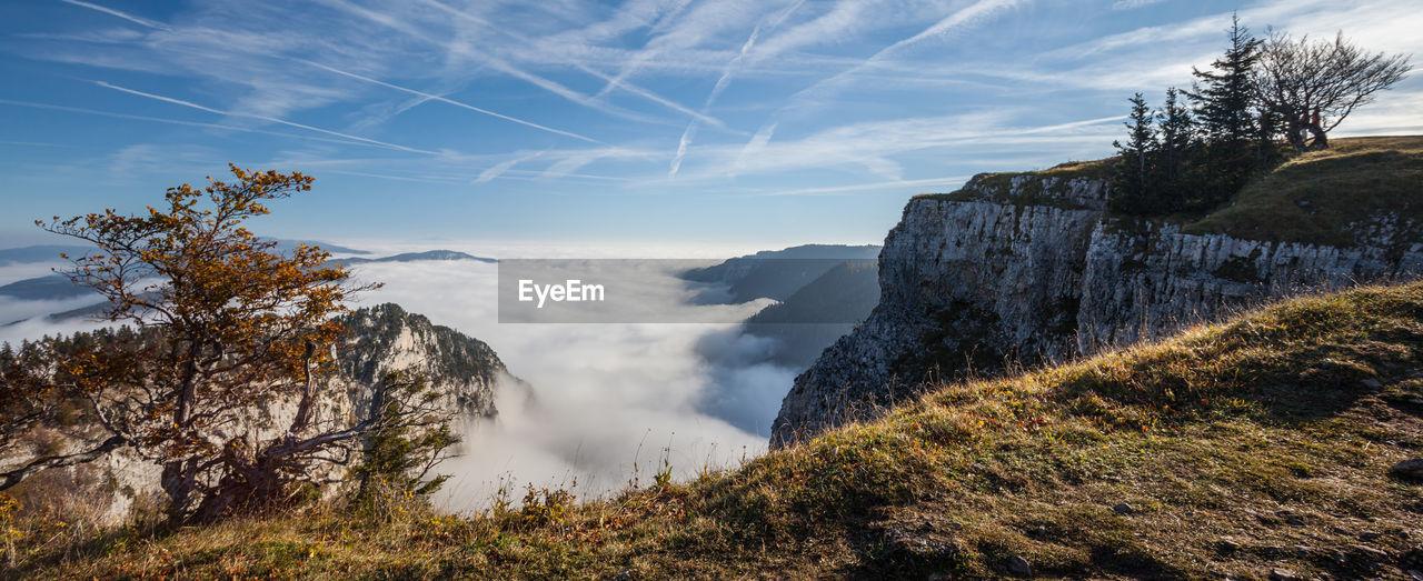 Scenic View Of Creux Du Van Against Sky