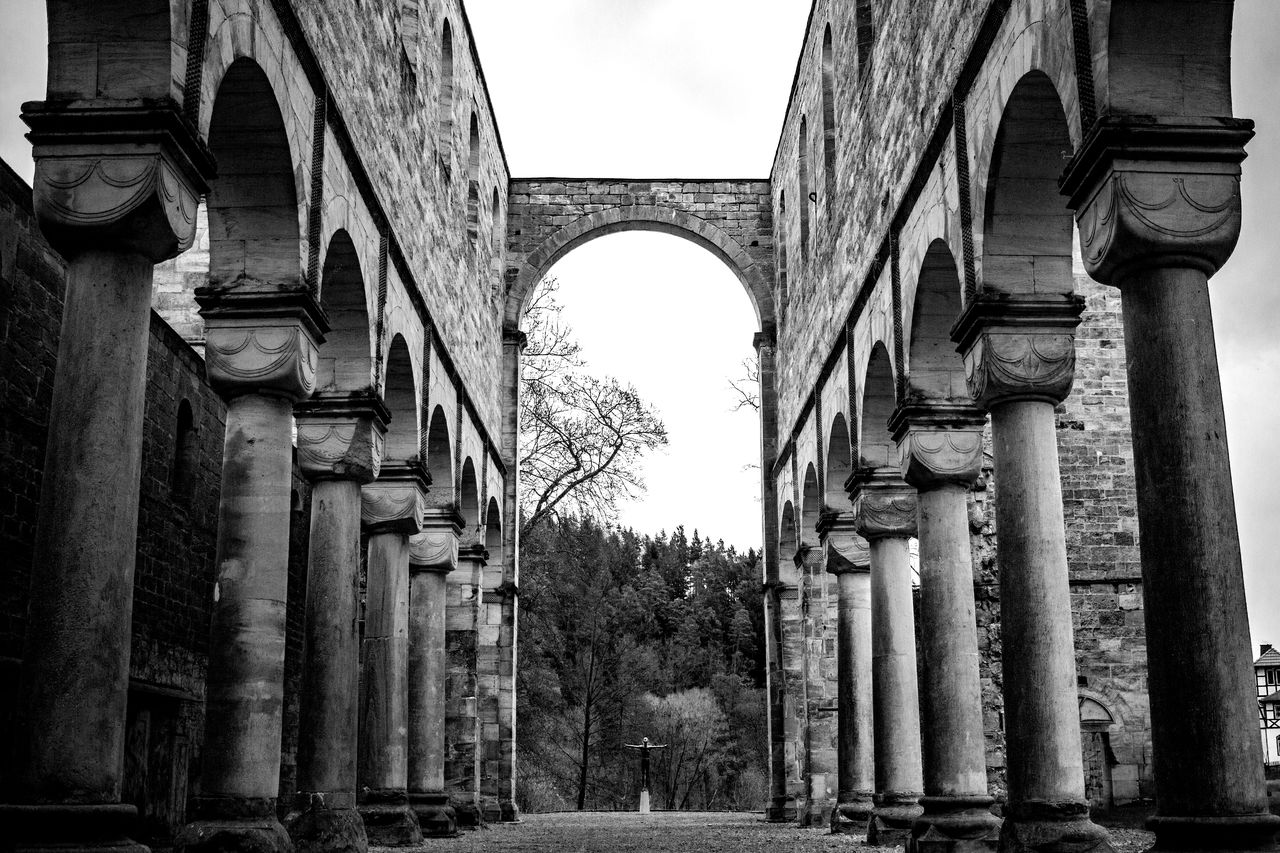architecture, built structure, architectural column, arch, building exterior, history, the past, no people, day, building, low angle view, old, sky, ancient, religion, outdoors, nature, belief, plant, travel destinations, colonnade, ancient civilization, archaeology