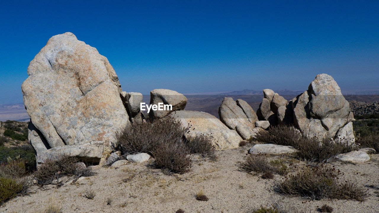VIEW OF ROCK FORMATION AGAINST CLEAR BLUE SKY