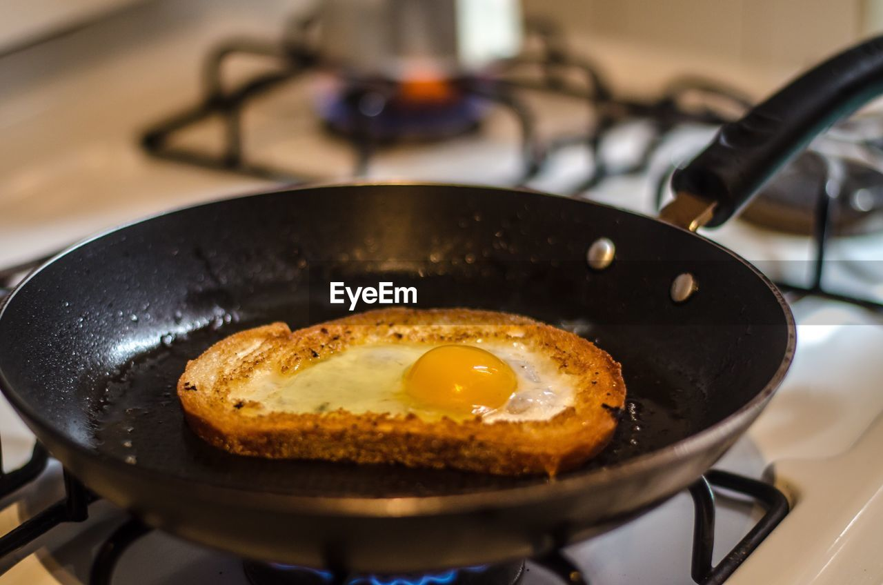 Close-Up Of Egg Yolk In Pan On Stove