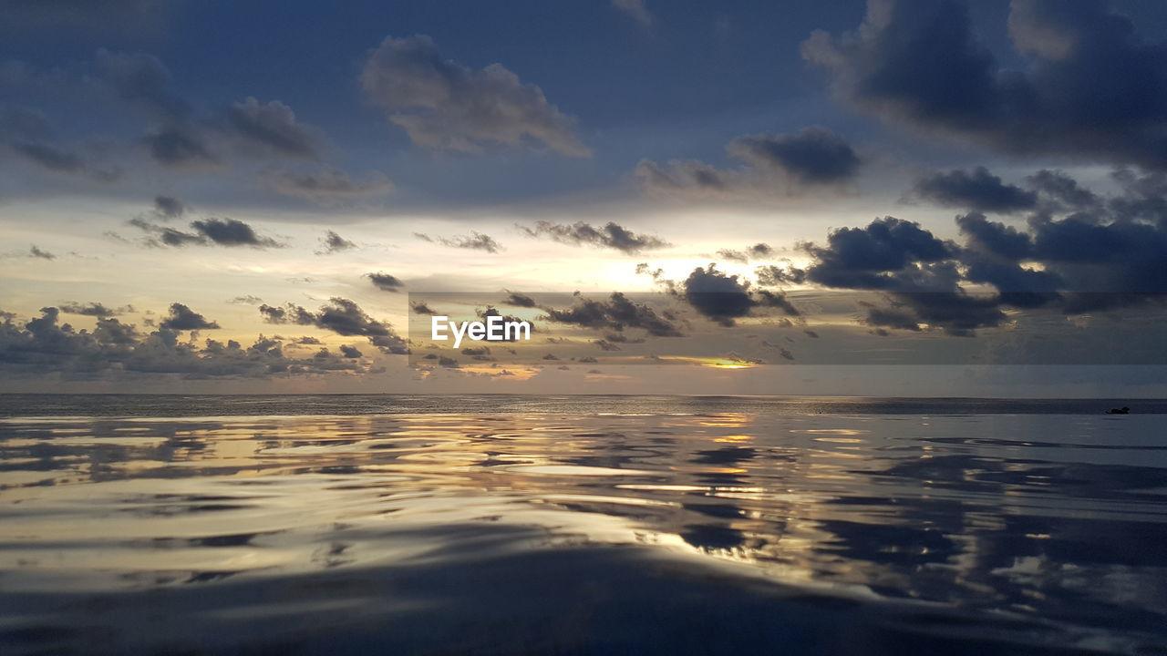 sky, cloud - sky, beauty in nature, water, tranquility, scenics - nature, sunset, tranquil scene, sea, reflection, nature, no people, idyllic, horizon over water, beach, horizon, land, outdoors, non-urban scene