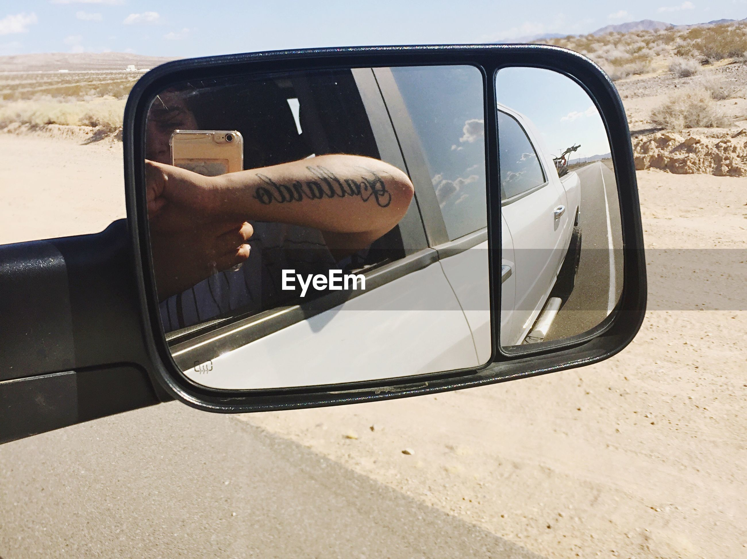 mode of transport, car, transportation, land vehicle, travel, street, side-view mirror, part of, road, car interior, reflection, close-up, road trip, day, outdoors, cloud - sky